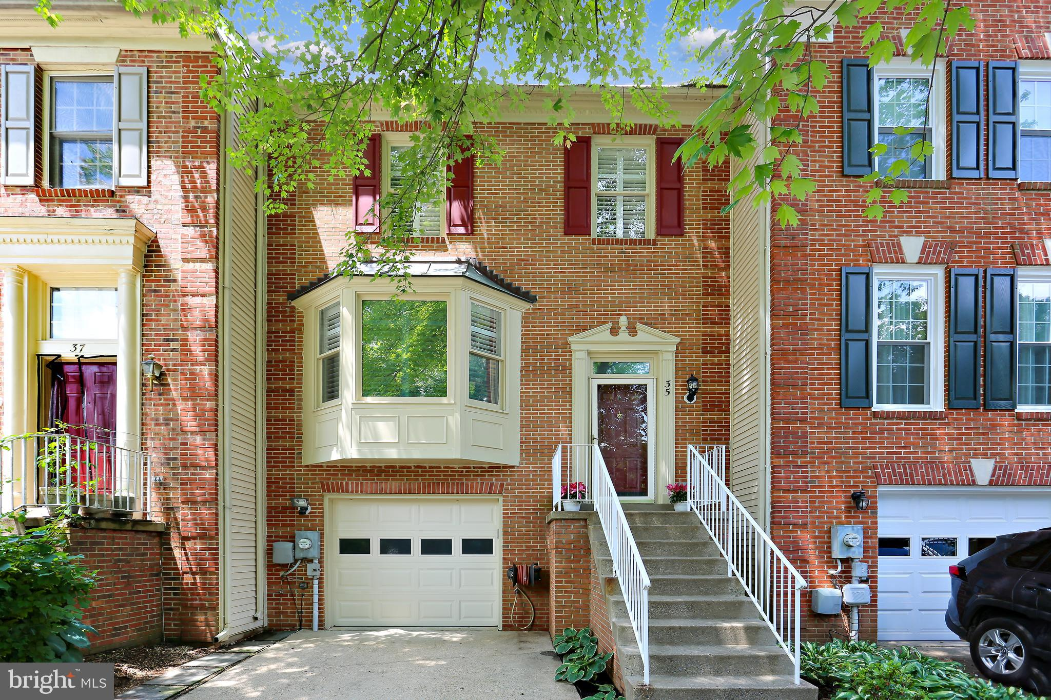 Beautiful brick-front townhouse on private cul-de-sac.  Kitchen renovated in 2020, all 3 full and 1/