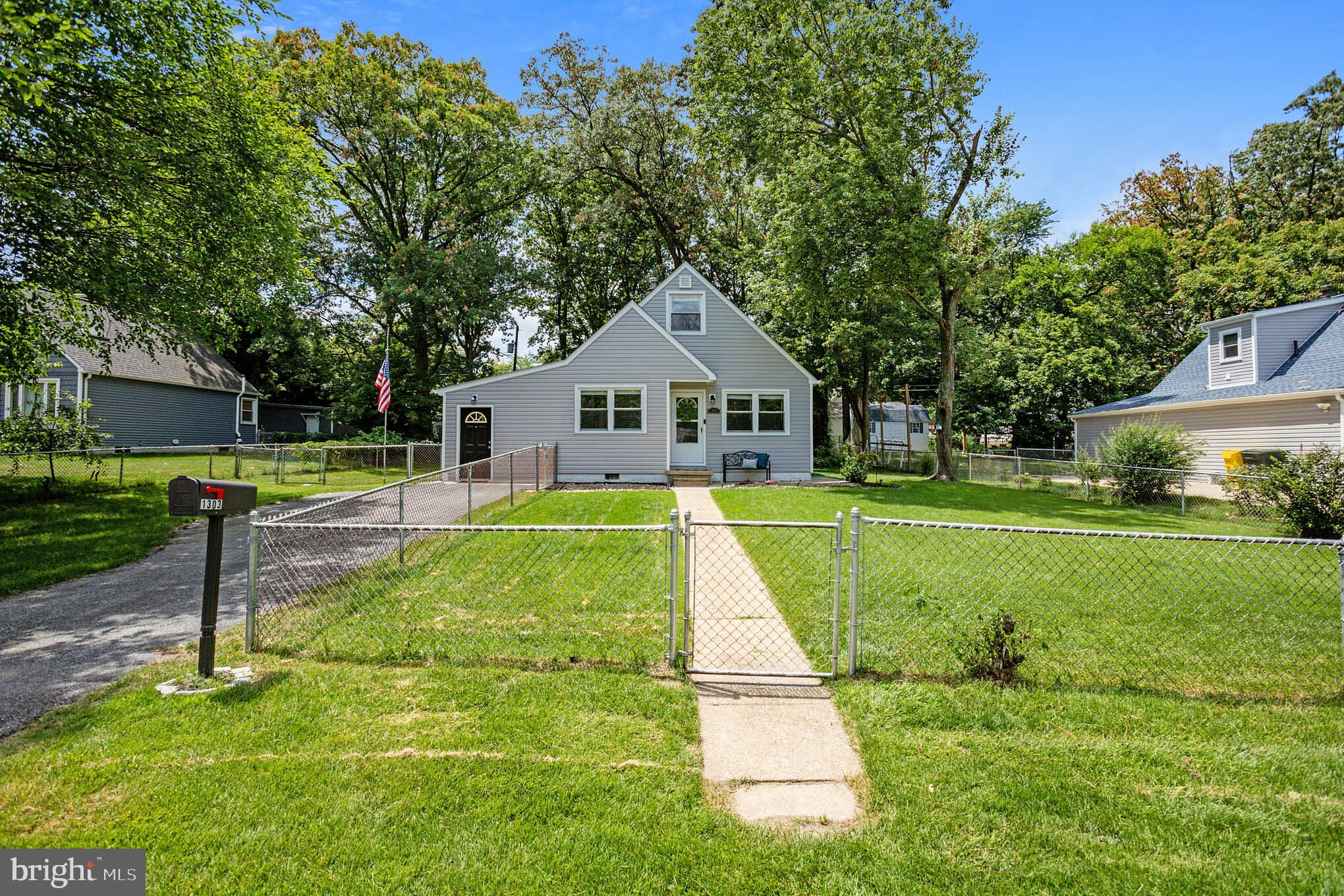 Gorgeous renovated cape cod. The open entry level and main floor flows with beautiful hardwood floor