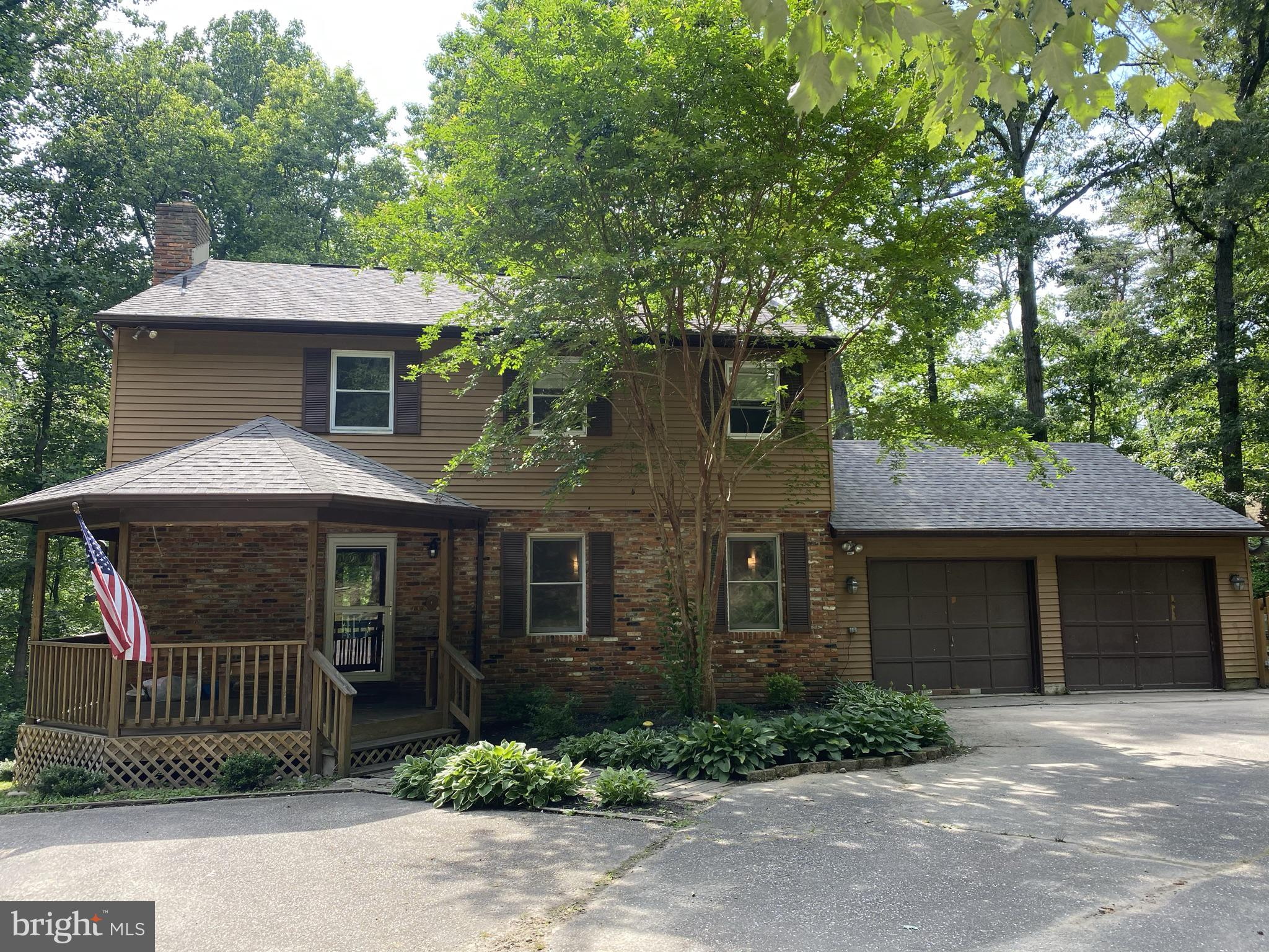 Rare find! Nestled on 1.62 wooded acres that borders State Park & Severn Run (a flowing stream off the Severn River) * 4 Large Bedrooms on upper level and separate 5th bedroom/in-law suite with full bath in finished lower level with second kitchen! Long Driveway leads you to your private oasis set back from the road - perfect for the growing family or a great space to work remotely. Beautiful wooded lot with greenspace and so many places to enjoy your morning coffee or afternoon yoga. Choose the front covered porch, the back deck & patio area, or relax in the kitchen over-looking the wooded back yard. Lots of natural light flows through this open kitchen with breakfast bar, and charming family room with pellet stove. Separate dining room and living room add even more living space!  Master Bedroom with two closets, updated bathroom. Roof has been replaced in the past 4 years. This hideaway has a two car garage, outdoor shed, separate potting shed, fire pit area...with a little outdoor love this could truly be a gardeners delight! Bring your family and your custom touches & make this your perfect dream home! Minutes to NSA, Fort Meade, Annapolis, and conveniently located in between DC & Baltimore.