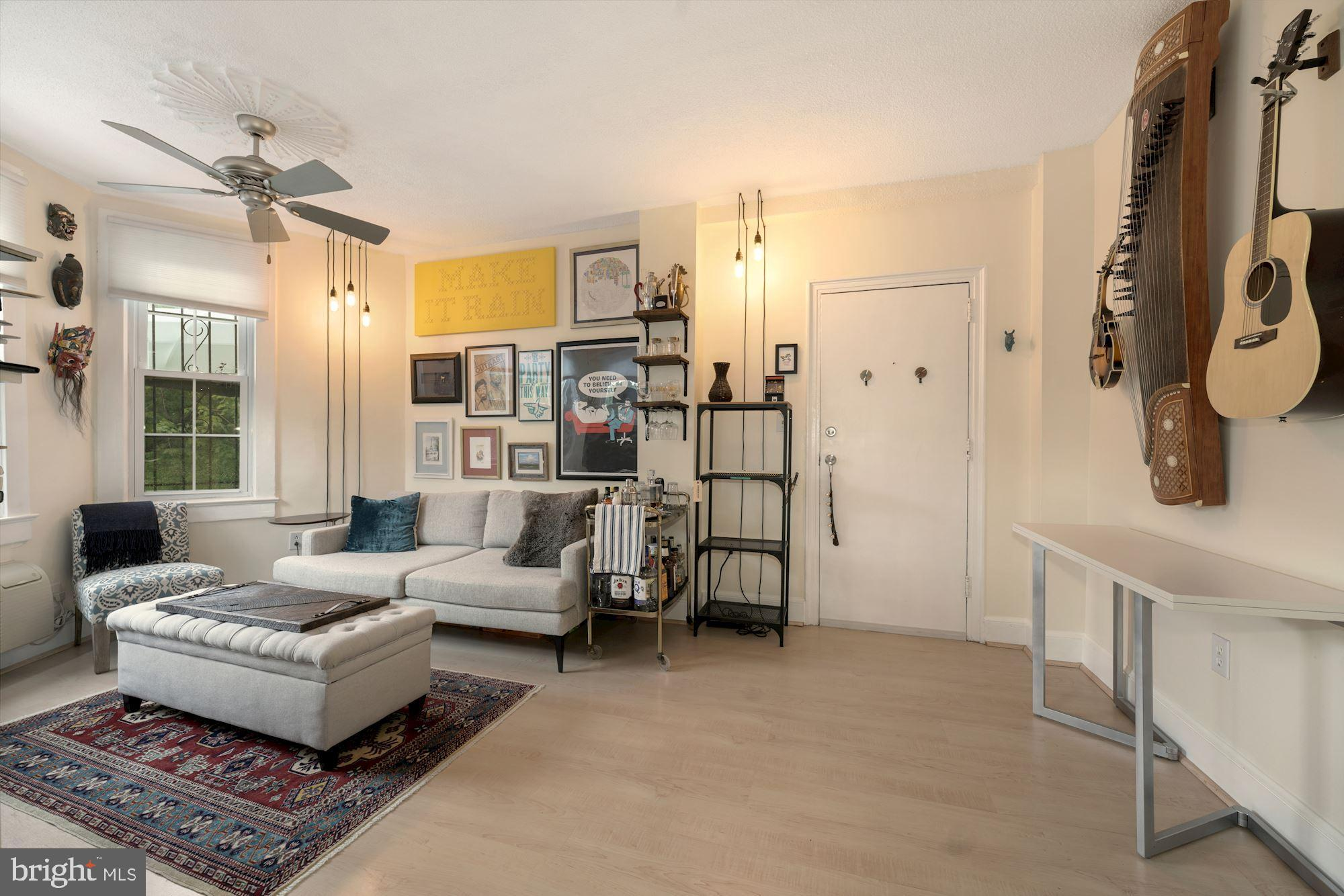 Sun-drenched 1BR in boutique building w/ FRONT-FACING bay window, washer / dryer, hall closet for st