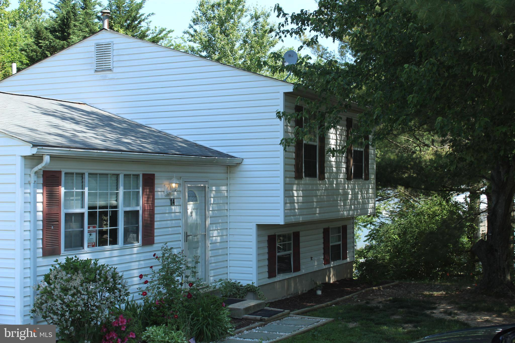 This 3 bedroom,  2 full bath , sunlit, split level home is  located in a cul-de-sac with a great rea