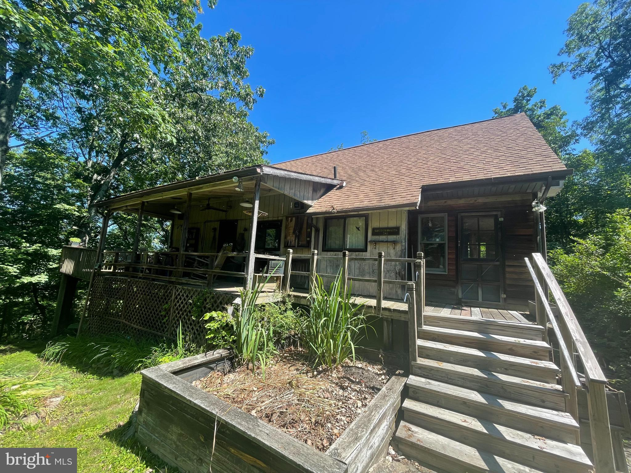 Tons of Potential with this remote Chalet located in Glenwood Forrest.  Situated on 4.60 acres, on t
