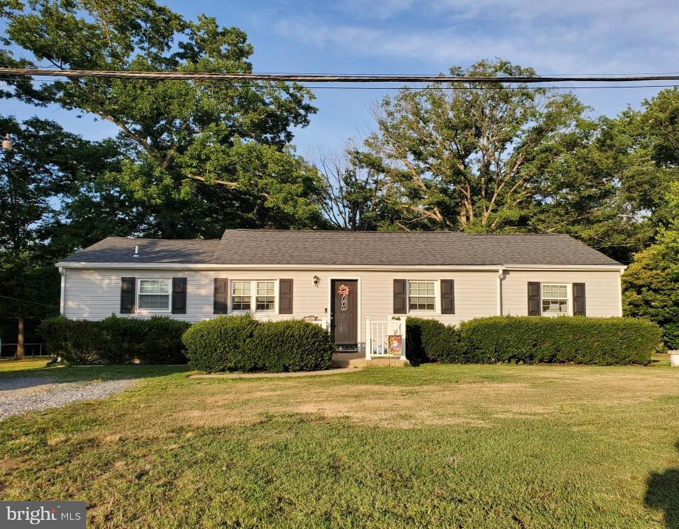 Don't miss out on this beautiful Rambler located minutes away from I-95, route 1, shopping and restaurants. Fully renovated to code in 2013 with new roof, plumbing, electric, windows, HVAC, wood floors. Features a high efficiency tankless hot water system. Lovely kitchen with cherry cabinets and granite counters. Comes with stainless steel appliances and a perfectly sized shed for your extra storage or a hidden getaway to the spacious backyard!! Can't go wrong with the convenience of a one level living.