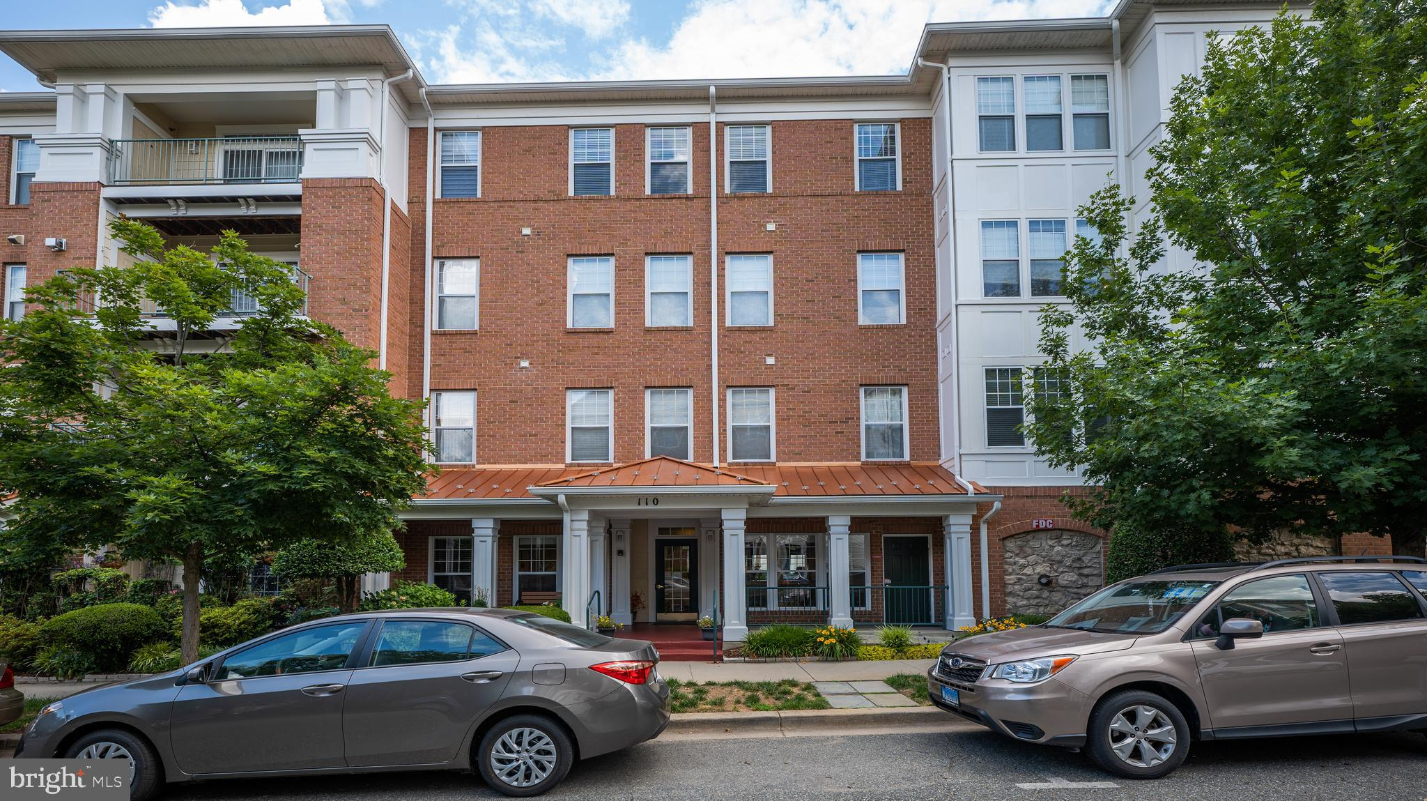 Welcome to this sun filled two bed, two bath corner unit condo with elevator access located in the K