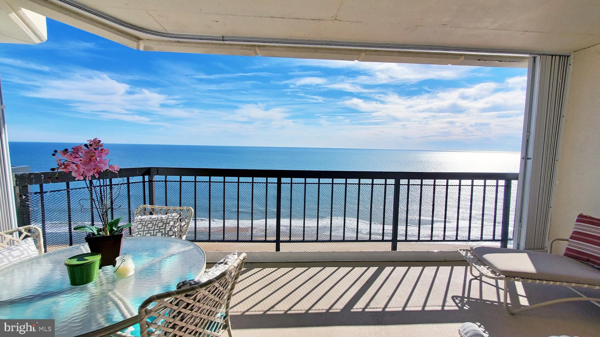 Opportunity Knocks with this Direct Oceanfront 2Bedroom/2Bath Penthouse Condo in a masonry building with spectacular views from both the Beachfront and Bay View Balconies!  Live the beach life enjoying both Sunsets and Sunrises all from the privacy of the two oversized balconies.  The condo features hurricane shutters, tile floors, newly renovated bathrooms, updated kitchen and a newer full-size washer and dryer.  You will notice the large living area with room to spread out while gazing at the beautiful horizon of the Atlantic Ocean.  Conveniently located in North Ocean City near Northside Park, restaurants, shopping, theaters, mall, and grocery stores.  The condo comes complete the viewing of the fourth of July fireworks right from your bay view balcony!  The building offers an indoor pool, secure newly renovated lobby and two parking spots. Did I forget to mention the private storage closet located on your Bay View Balcony?  Make sure you look at the renderings under documents for beautiful new lobby to be completed by Summer…  Do not miss this opportunity to own a private Penthouse Condo in this well-maintained Direct Oceanfront Building!