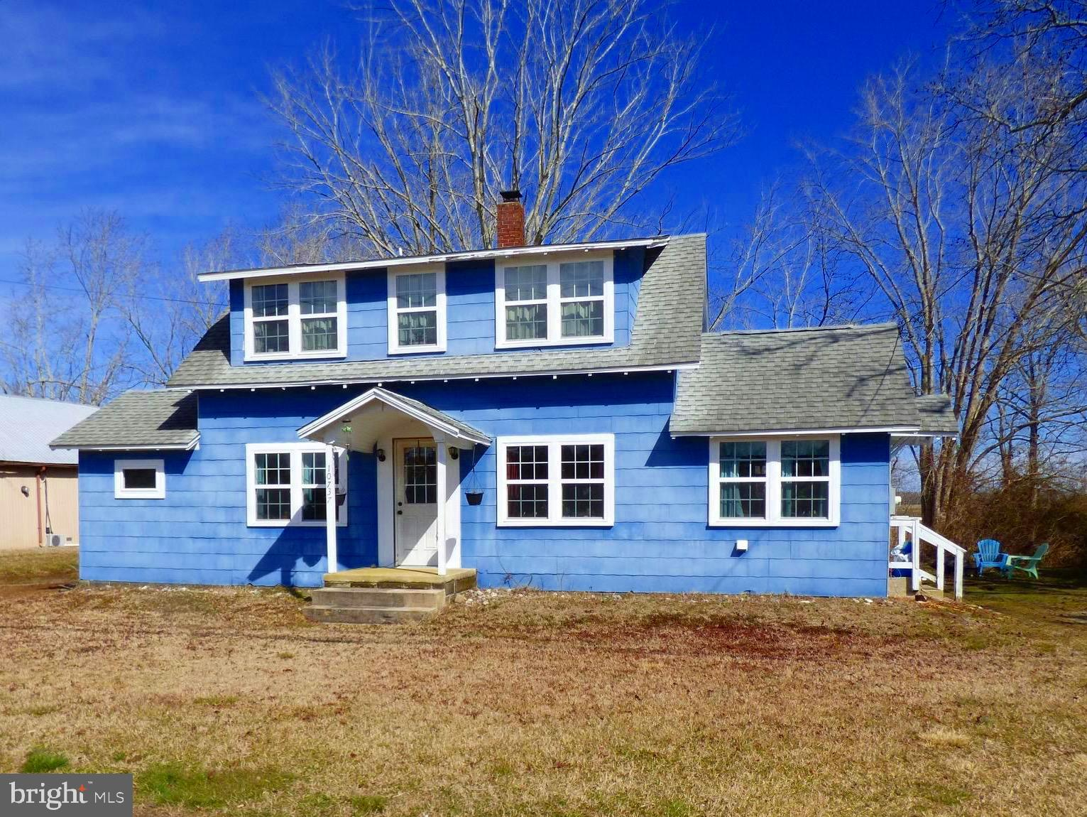 COTTAGE CUTENESS! Just 10 minutes from Ocean City!  Two large bedrooms plus den, formal dining room