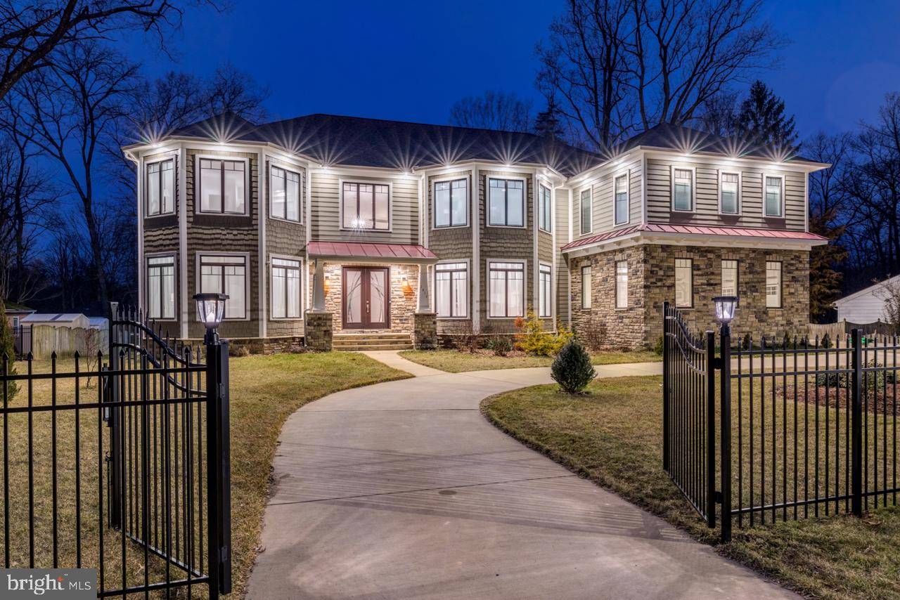A PRIZED TREASURE: This like-new, custom-built, modern Craftsman-style home is nestled on a prime .5