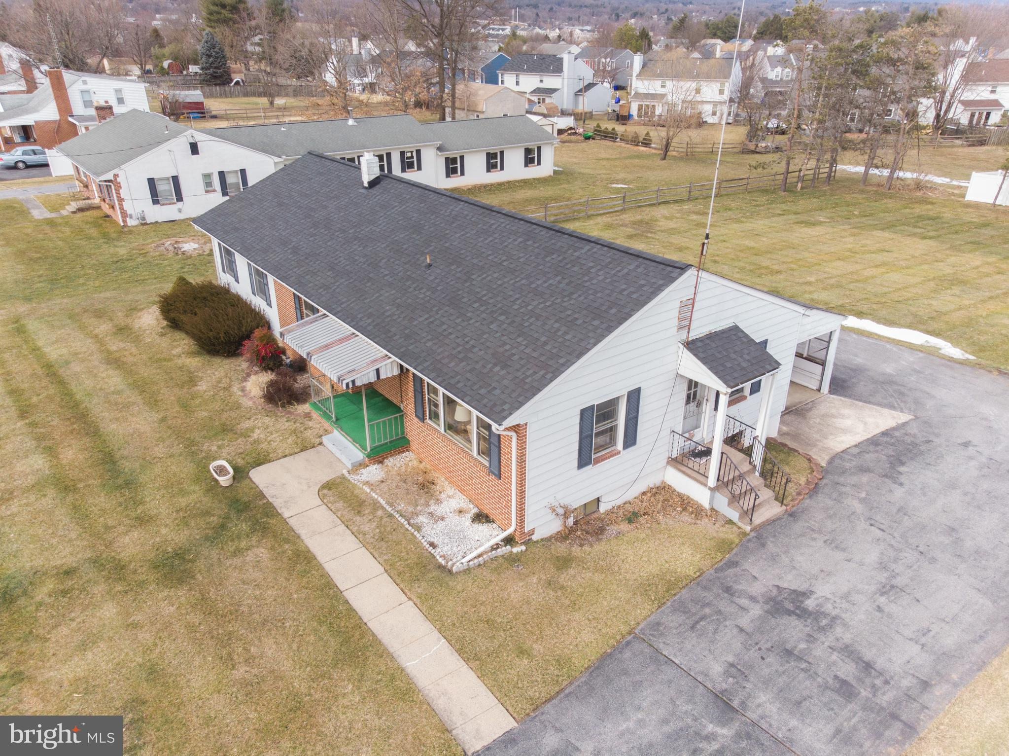 Ernie Ausherman Custom Built 4 Bedroom Rancher on a Great Lot! Walk into your spacious living room w
