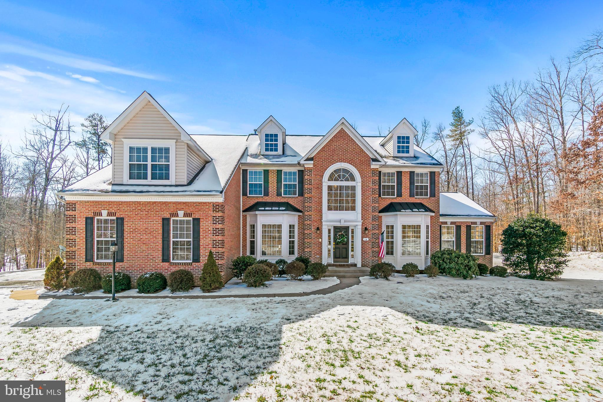 This feels like home! Yes it does! This beautiful  brick front home is  located on 3.01 acres in a s