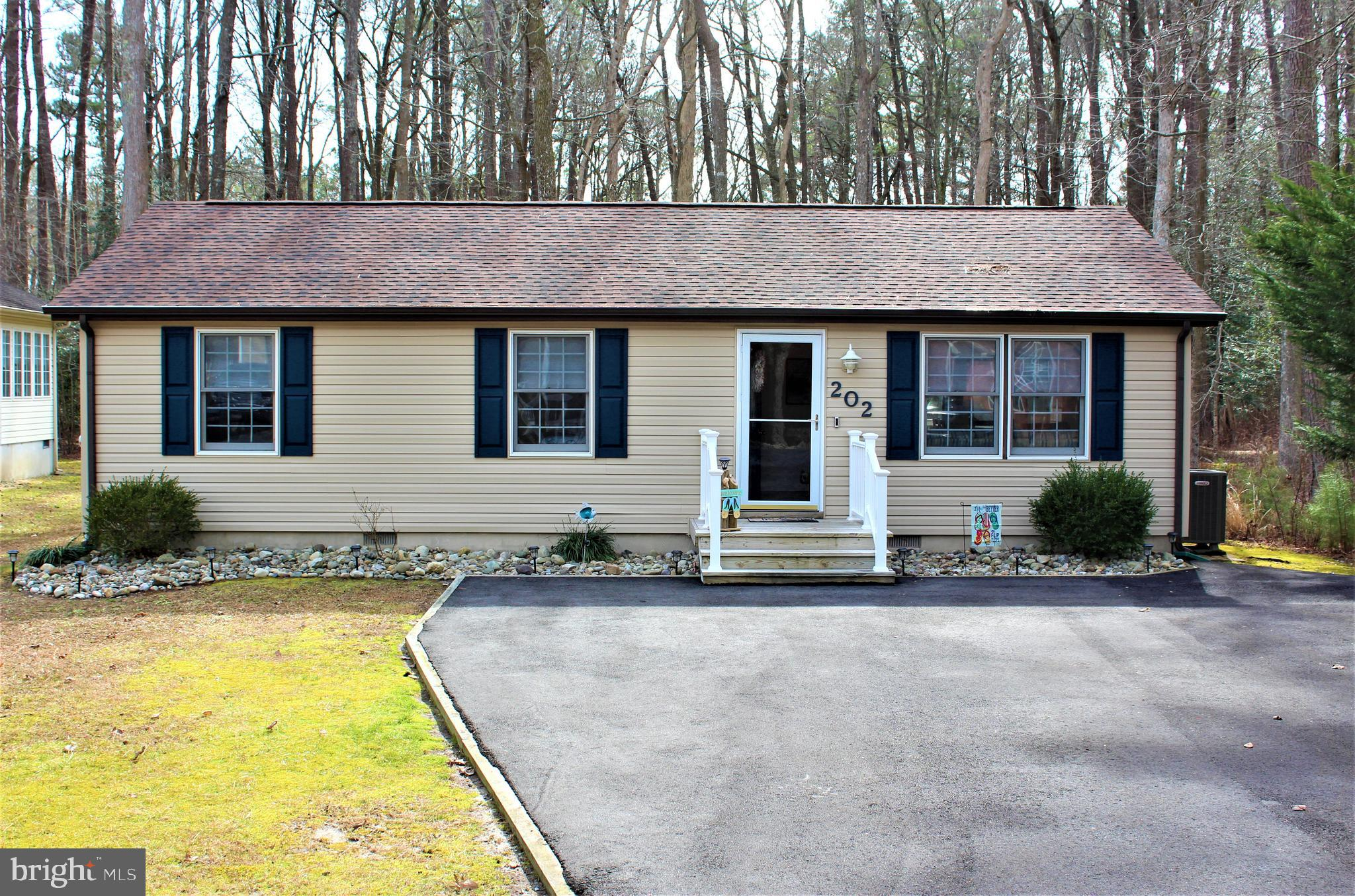 Coastal contemporary completely remodeled 3BR home nestled in Ocean Pines only minutes from the beac