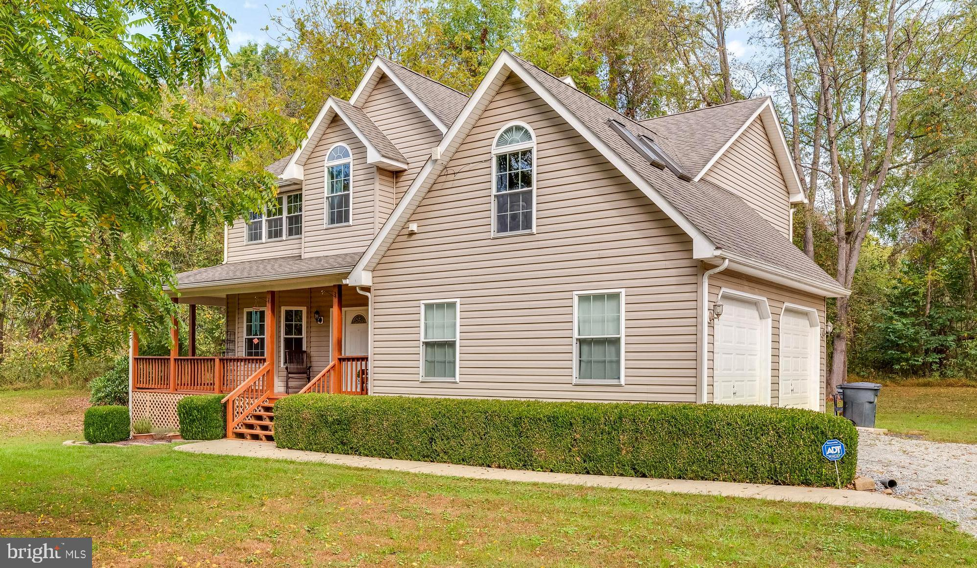 Stylish  custom colonial on 1.5 acre lot.   No HOA - bring the chickens and the RV! Property has bee
