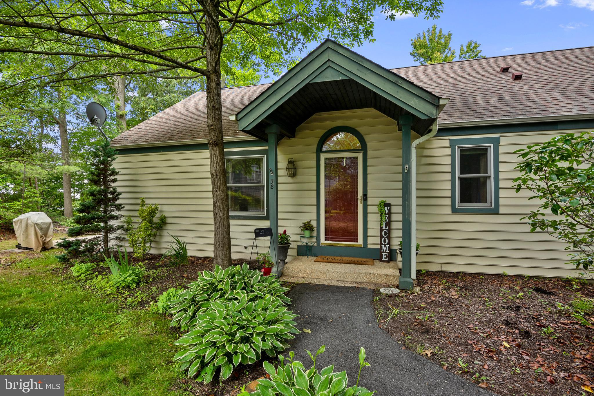 No showings until Saturday, June 19th at 9am.  This spacious and charming carriage house is sheltere