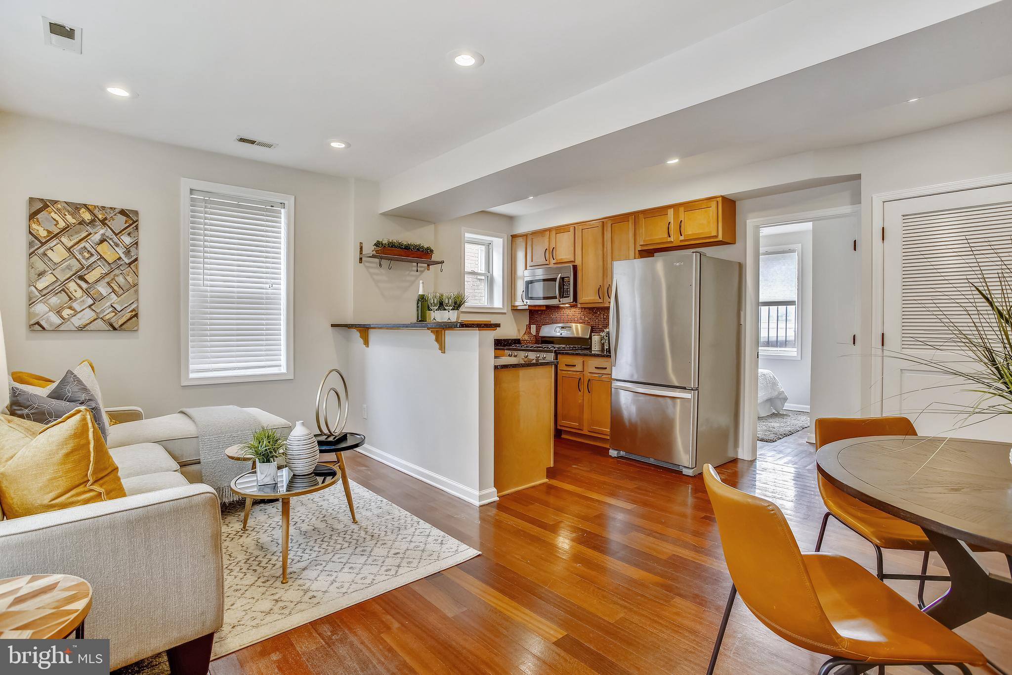 Discover the best in DC condo life! 2BR/1BA home located in historic Eckington. 617 square feet of light-drenched, open living space. Wood floors, stylish kitchen, in-unit washer/dryer, internal A/C, back porch for pleasant mornings and evenings. Live just a pleasant stroll from Union Market, bars and cafes, shopping and dining, major city bus routes, and a Red Line Metro station. Everything you could possibly want from an urban experience is right here at your fingertips. Come check it out for yourself! <b>OPEN HOUSE SUN 1-4</b>