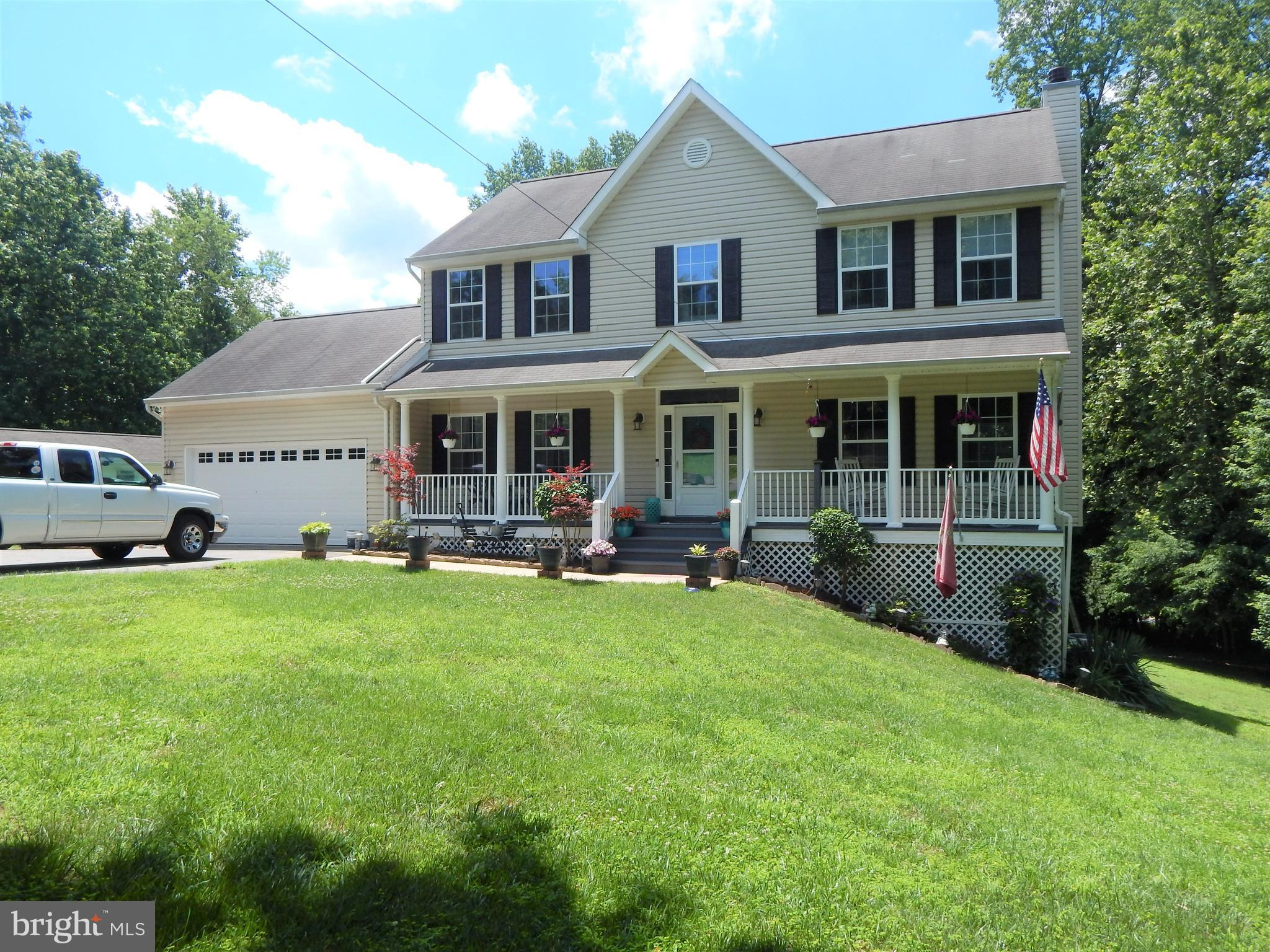 Beautiful Colonial locacted in Peach Blossom Farms.  4 bedrooms and 3 full and 1/2 bath.  Large Livi