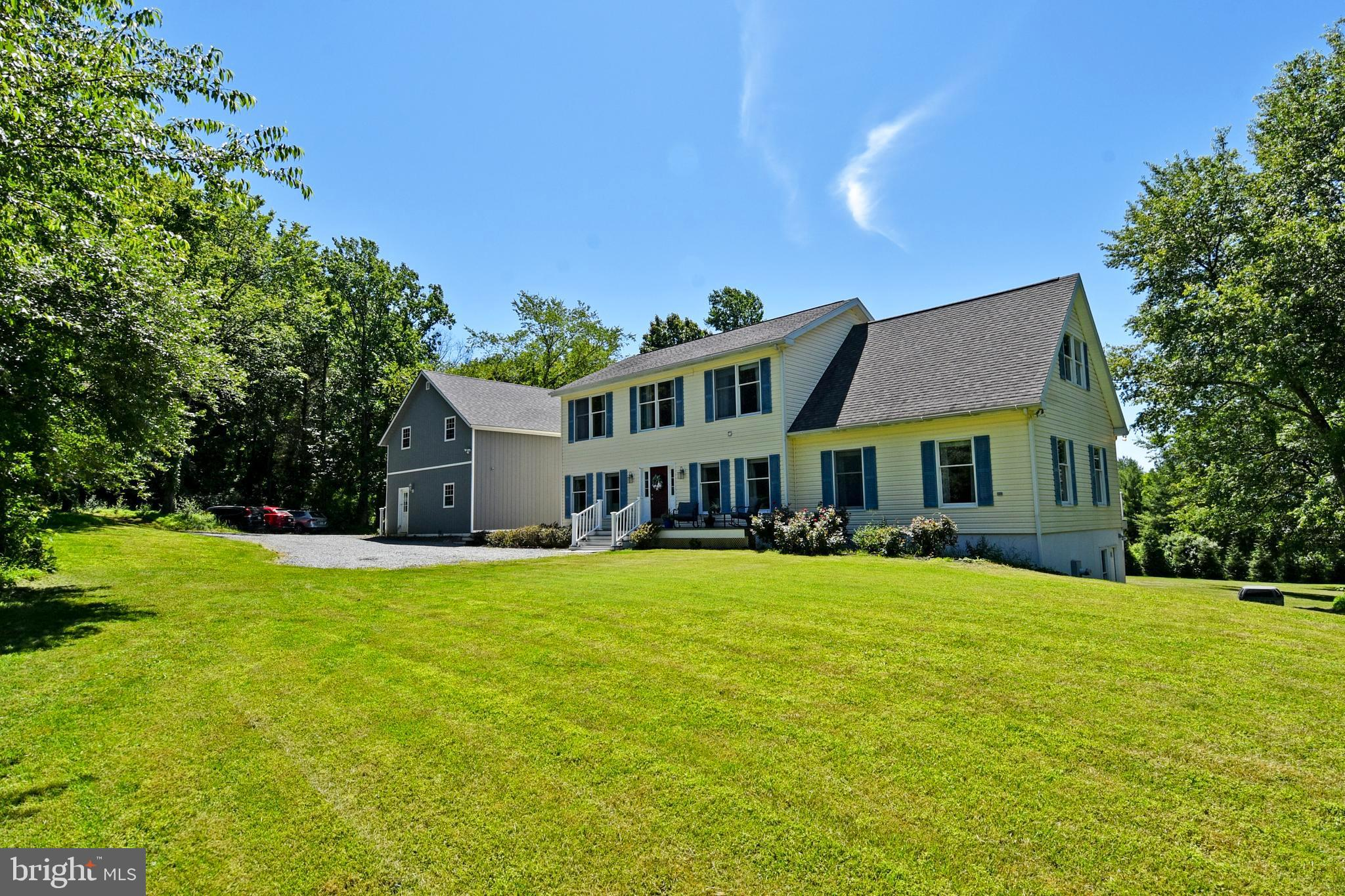This 3+ acre property is nestled amongst mature trees and open space with beautiful, awe-inspiring v