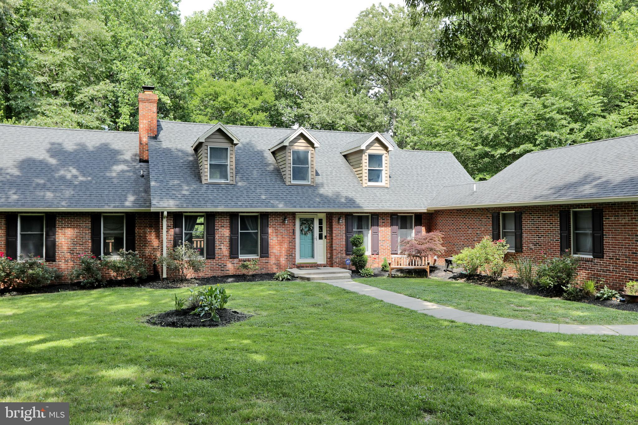 Gorgeous Brick Cape Cod on 5+ acres tucked away,  perfect lot if you're looking for peace & privacy.