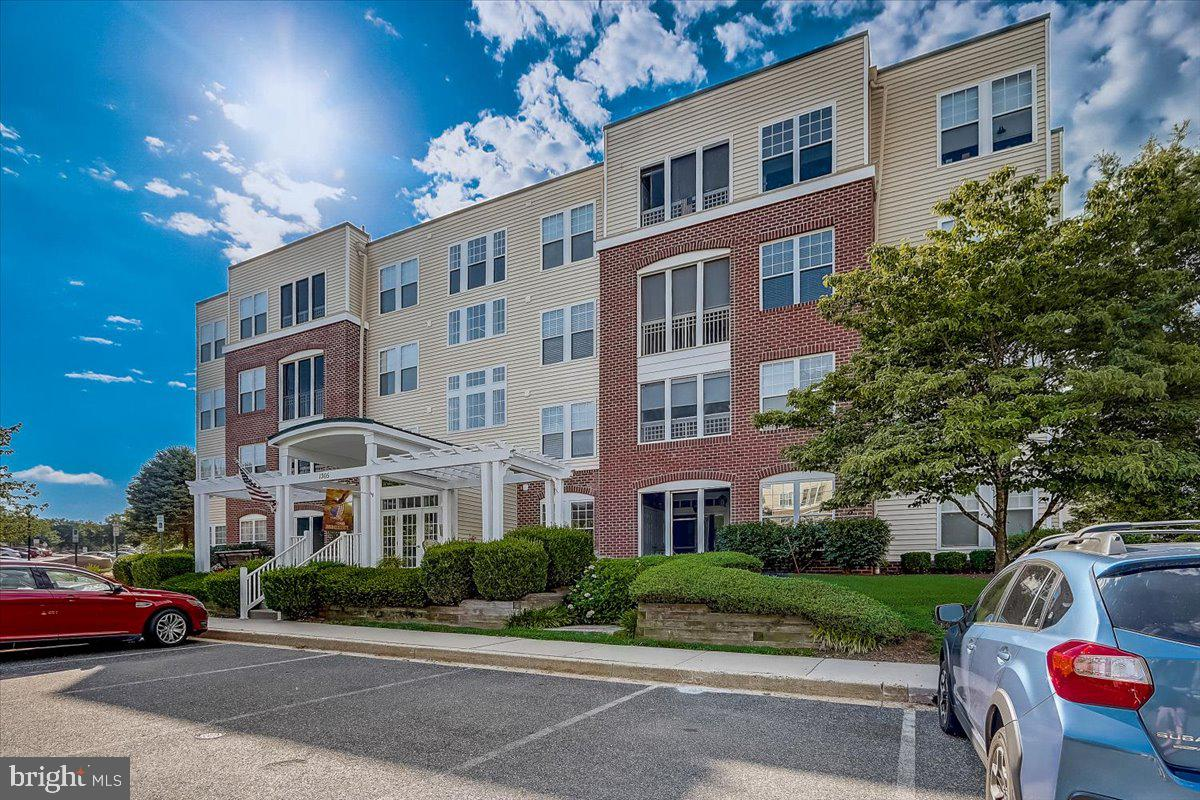 Rarely Available Entry Level  Condo  2 BR, 2 Full Bath  With  Separate Den AND/OR 3rd  Bedroom -  Spacious Floor Plan  With Screened  Patio Off Living Room  New Flooring 2019   AC 2019  Condo features Pool Tennis Courts and Fitness Center