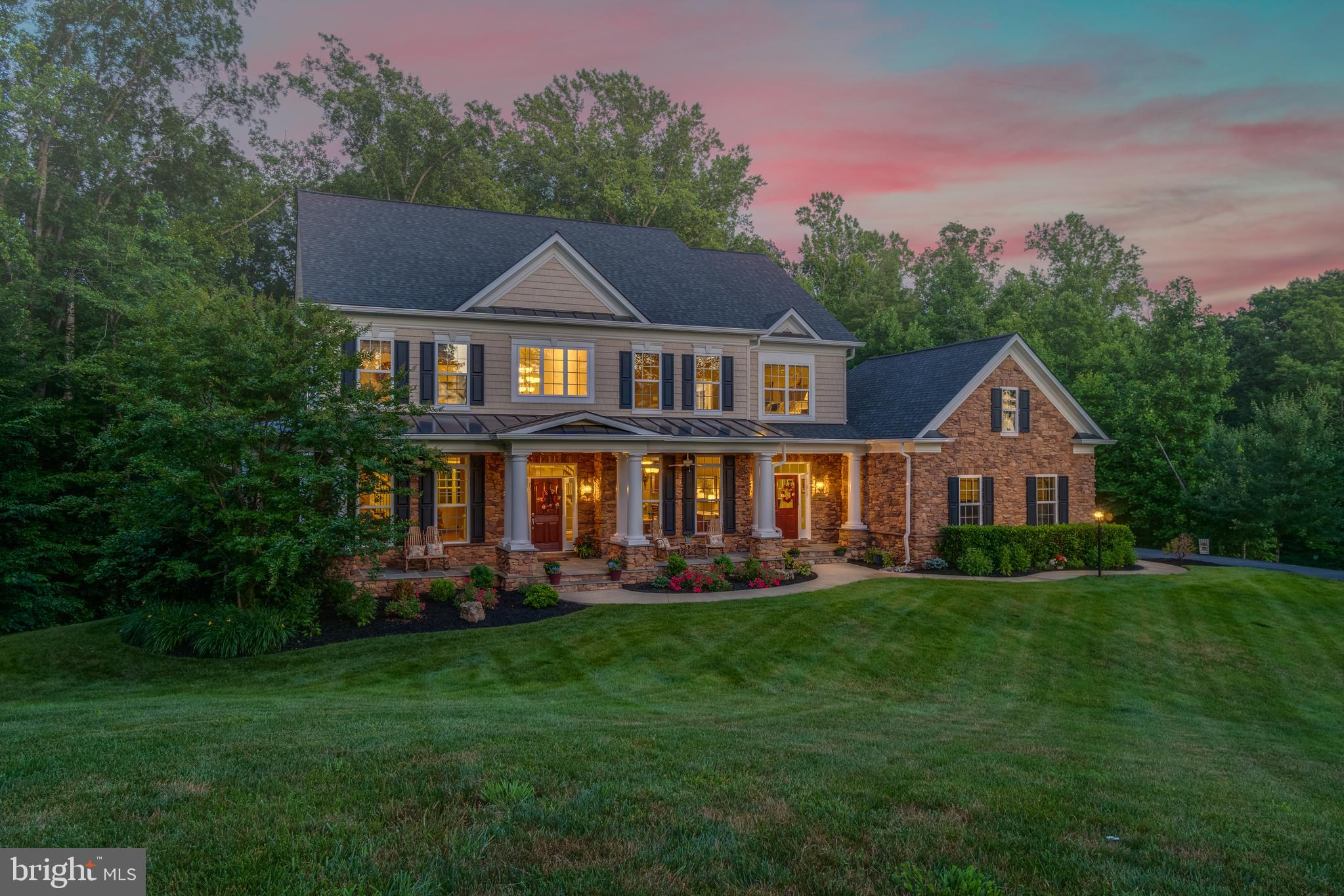 STUNNING Colonial situated on over 3 acres in the much sought after Glens Neighborhood.  Beautiful S