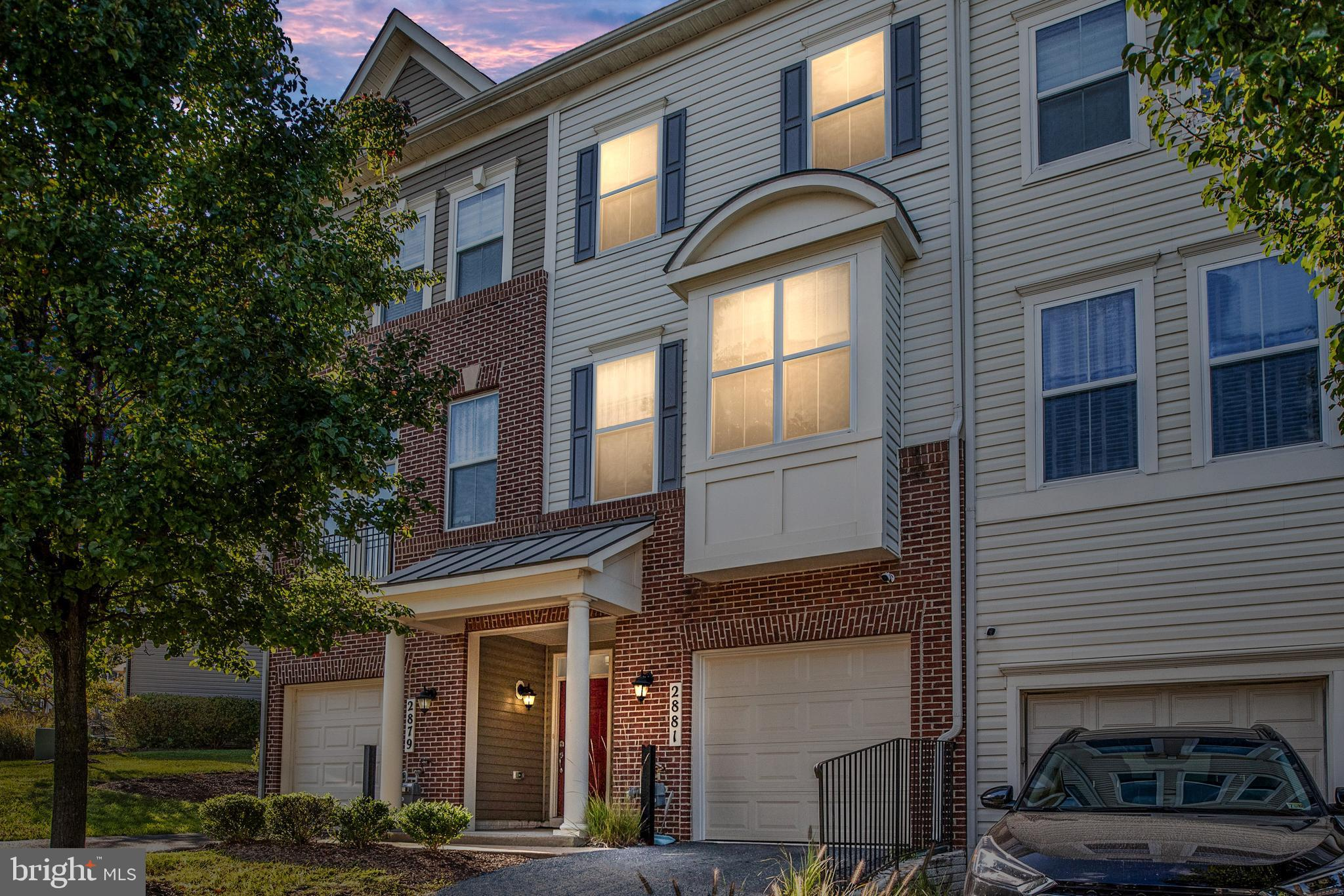Move in ready. Beautiful three story townhome with 1 car garage. Walk into hardwood foyer with main level bedroom and full bathroom, all three levels have 9'foot celings, recess lighting throughout, excellent dimensions , all hardwood on kitchen, livingroom and diningroom level with upgrade trim. All new custom paint, new carpet in bedrooms, 30 year architectural roof, open kitchen with granite counter tops plus island , gas stove, spacious kitchen cabinets. Primary bedroom has double closets with luxury bathroom with soaker tub and separate shower with tile surround . Second bedroom has walk in closet with full bathroom. Gas heat and gas hot water heater, brand new hvac system in 2019. Premium home warranty included.