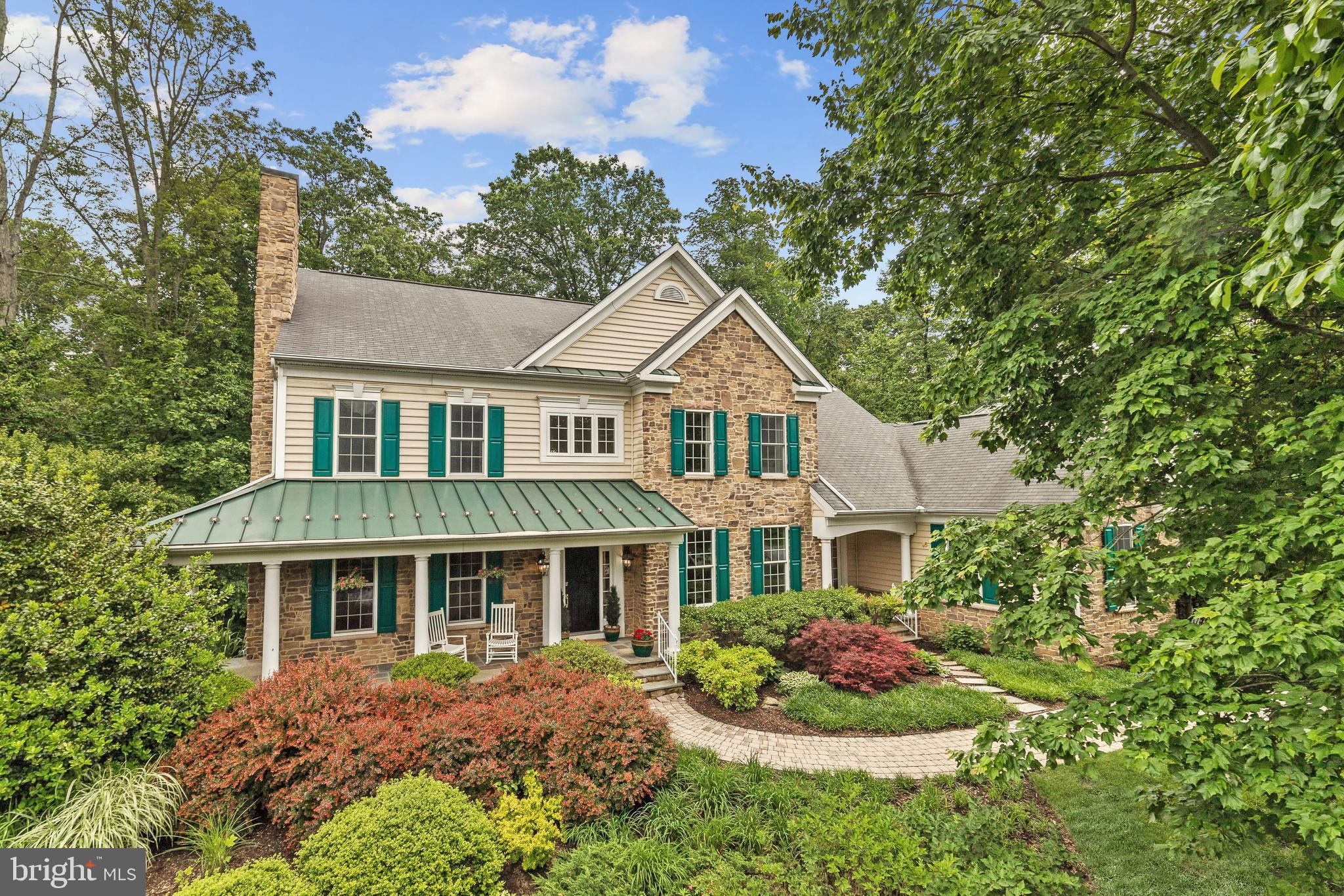 Absolutely stunning, stone front Transitional home nestled on over 1 acre and located in the coveted