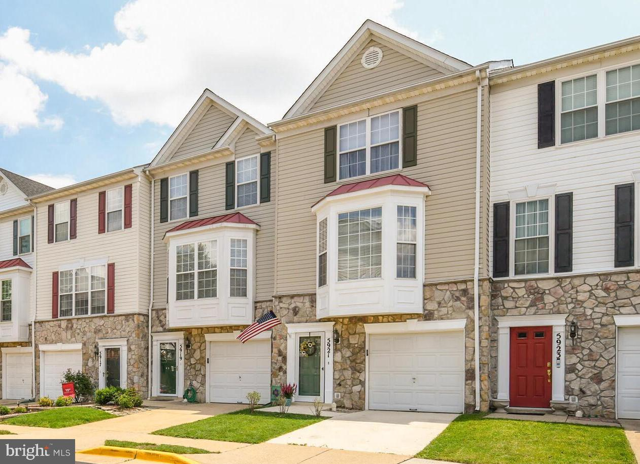 Fabulous Kingstowne garage townhome that has been upgraded and LOVED.   Newer hardwood floors, crown