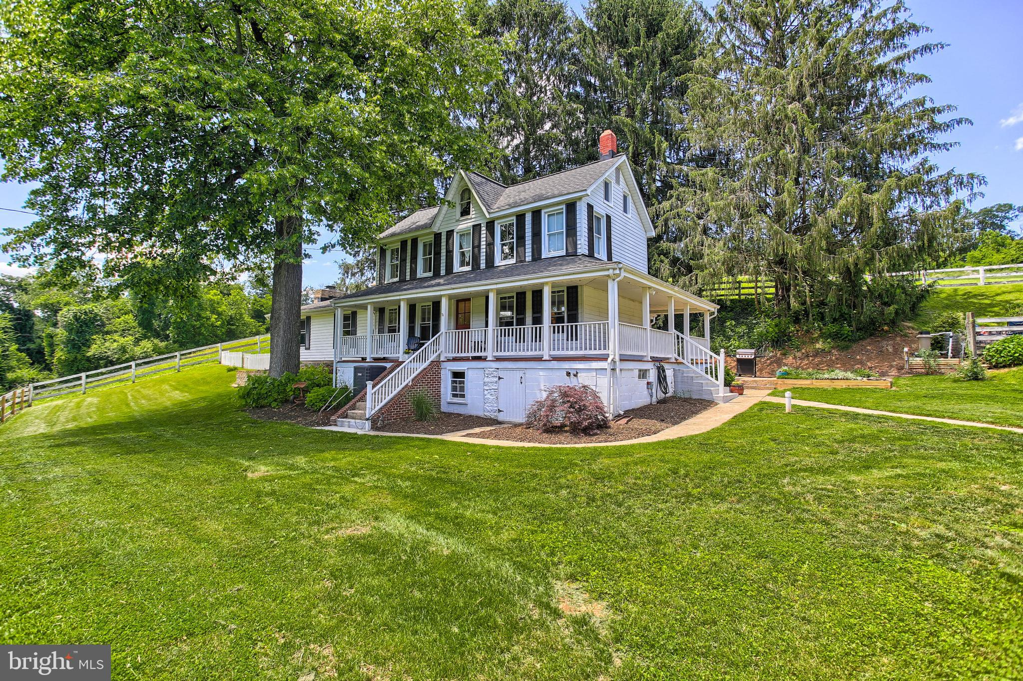 Must see farm for all horse lovers!  Renovated 4 bedroom 2 1/2 baths 2 story home on  peaceful 13.82