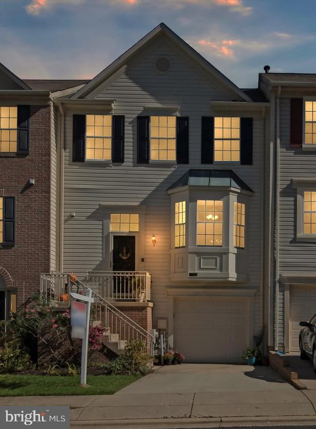 A perfect 10! Beautiful garage home in the Walden Community backs to the 10th green of Walden Golf C