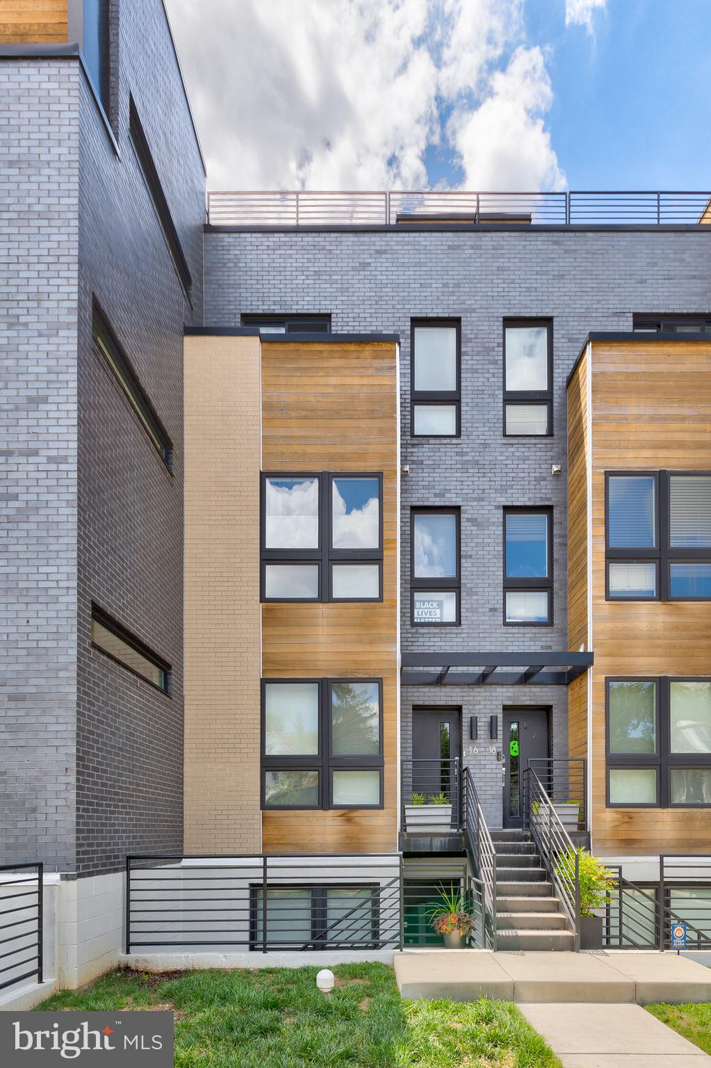 STUNNING New Listing at Brooks Row! This 2017 build modern boutique condo building is located in the