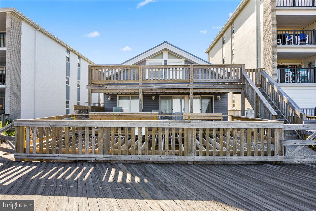 Opportunity is knocking for a DIRECT OCEAN FRONT SINGLE FAMILY HOME!  Don't miss your chance to own this 3BR 2BA recently remodeled single-family beach cottage ON THE BOARDWALK at 24th street.  Wake up and watch the sunrise over the beach.  Take a bike ride and enjoy all the attractions Ocean City has to offer.  The home has new siding, new roof, new decking, flooring, central air, and upgrades throughout. The exposed beams give this cottage old Ocean City charm and feel.  On the first floor you will find an open concept living area with plenty of room for family and friends. The dining area is off the living area and has a beautiful kitchen.  There is a first-floor master and full bath on this level as well. Off the first floor is a large deck perfect for crab feasts or just watching the world go by.   On the second level you will find two spacious bedrooms and a full bath.  One of the bedrooms has a full deck overlooking the boardwalk.  This home is rented weekly in CB Vacations weekly rentals and buyer must honor summer weekly rentals but keeps the rental income.  This would make a great second home or investment property.  Come take a look before it's SOLD! Can be shown on Sat. between rentals.