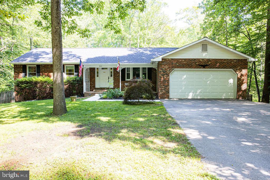 Beautiful brick rambler on 4 acres located on a mature lot with plenty of trees.  As you enter the f