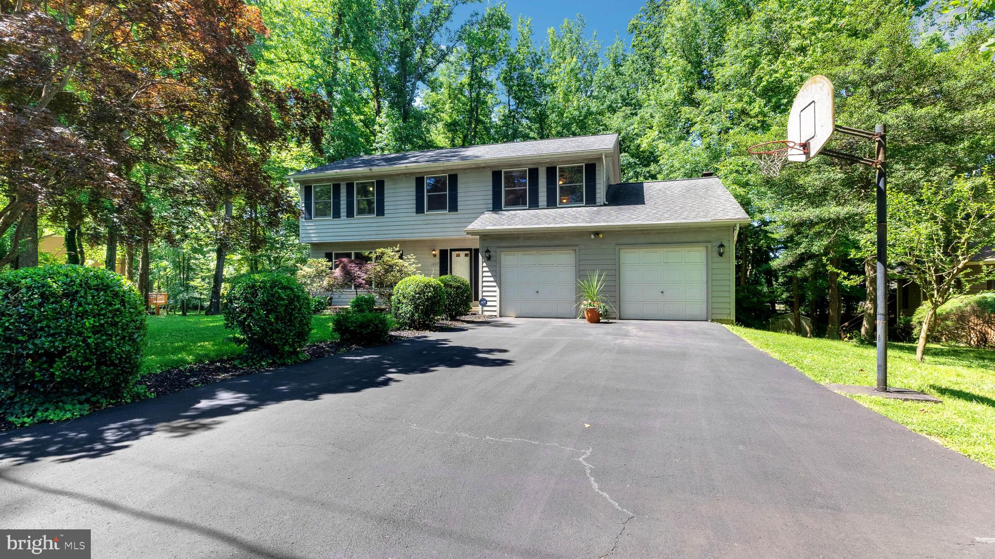 Beautifully maintained and loved. Relax on the back screened in deck and enjoy the woods. 3 Fully fi