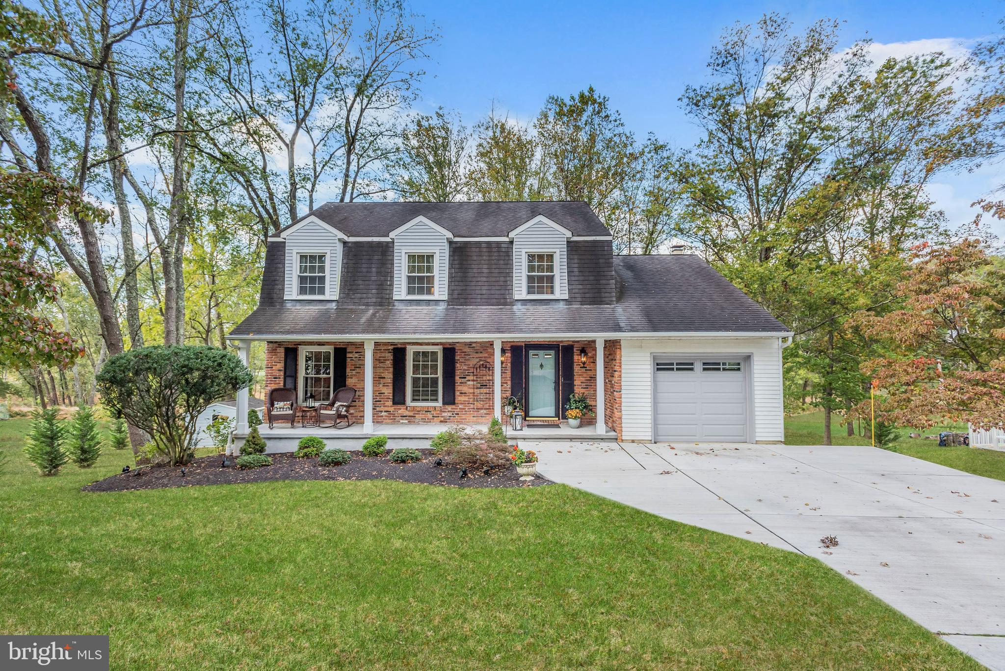 Beautiful Colonial, sited on almost half an acre backing to woods, boasts 3 finished floors with upd