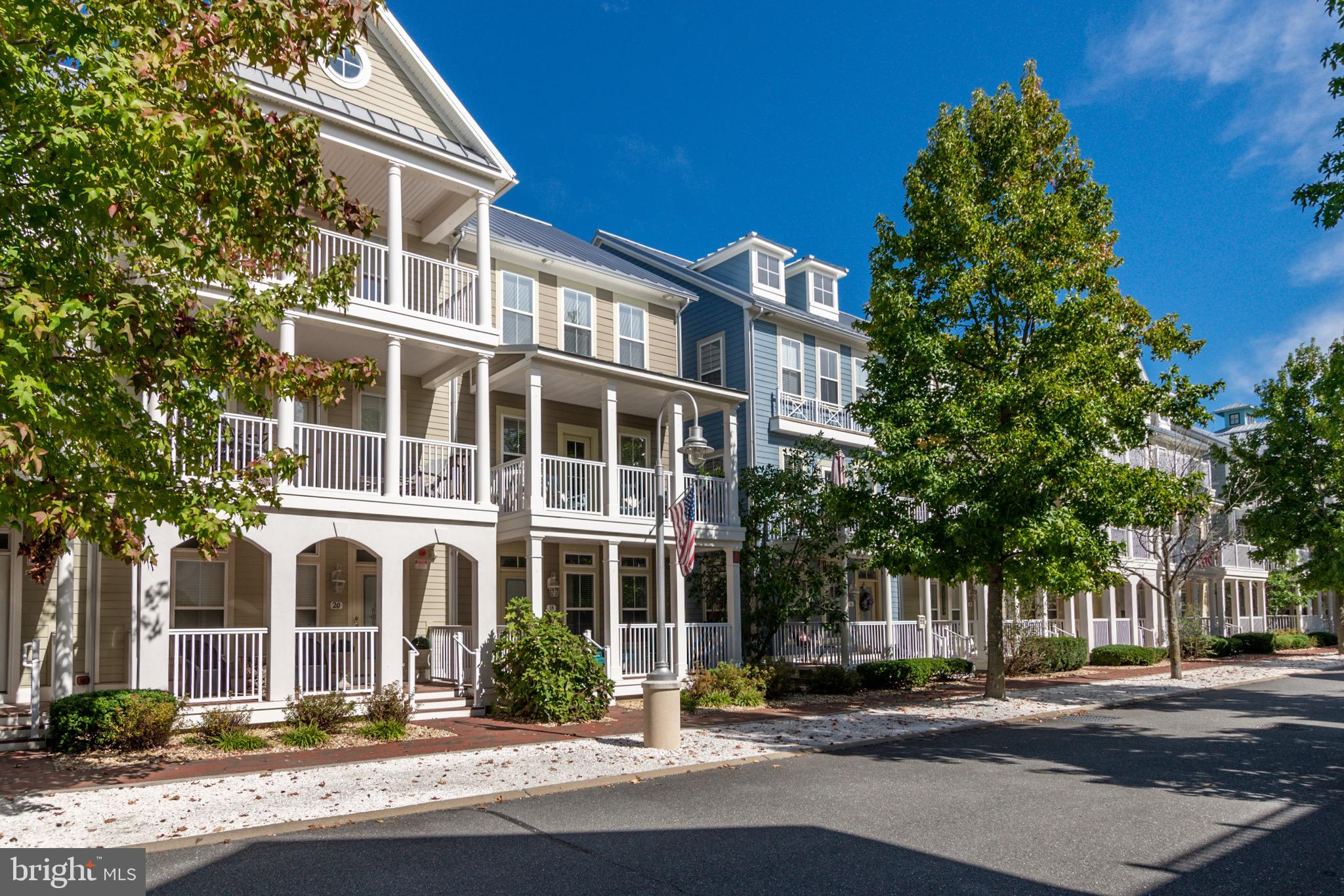 Located on a quiet tree lined street in beautiful Sunset Island this end of group townhouse is beautifully decorated, never been rented & sold fully furnished! Features include covered front porches, updated flooring, freshly painted and country eat-in kitchen w/ island. Just steps to the indoor and outdoor pools, fitness center, clubhouse, private beaches, interactive fountain and much more! This town home offers a large morning room right off the modern kitchen to enjoy with company. Features include solid surface counter tops, tile flooring, first floor den w/ potential to convert to a bedroom, private balconies, soaking tub in the master bath, open floor plan, and much more. The inviting & warm decor will leave you with the relaxed beach style of living all year round!