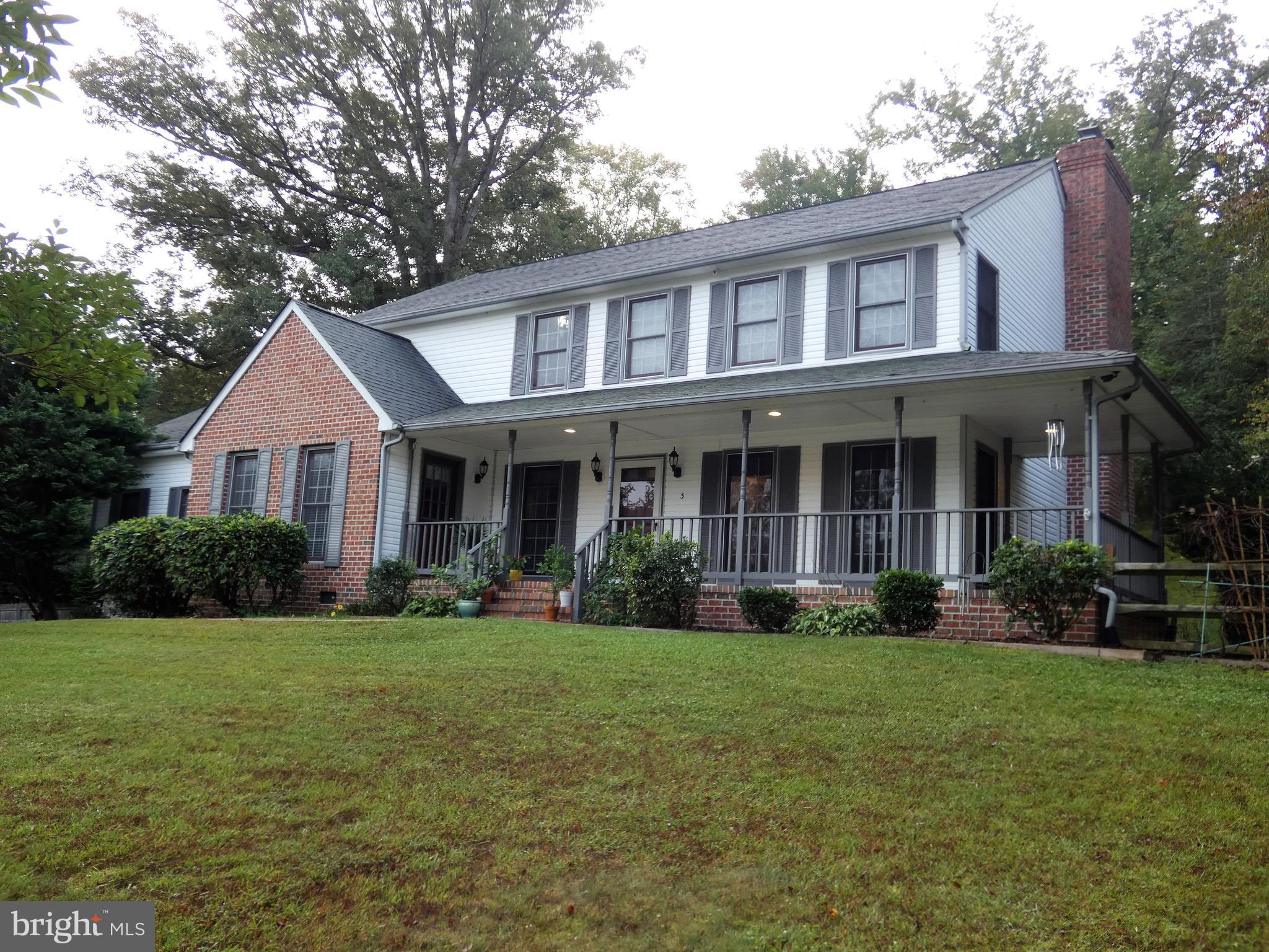 Large 3-level Colonial with over 4300 sq ft on Cul-de-sac  with over 1-acre Lot! This Home Boasts a