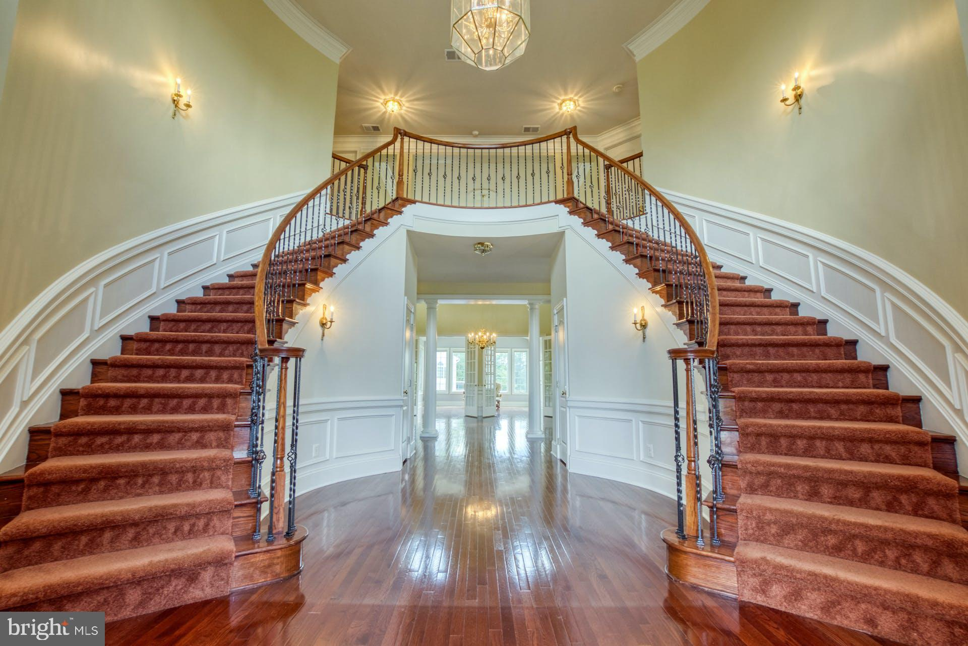 This exquisite Toll Brothers Malvern model, is one of the largest homes in stately Chase at Belmont