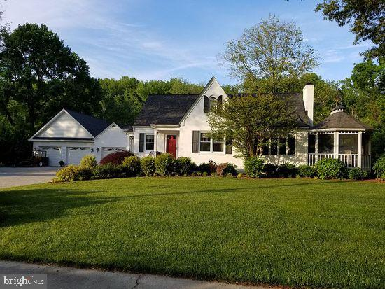 Beautiful historic solid brick cape cod home in a park-like setting near the Chesapeake Bay. Walk to deeded water access. Mayo Beach park a 5 min bicycle ride away. Hard to find character & charm - original wood floors, large vintage molding, arches, built-in shelving, etc. Four bedrooms, fireplace, screened porch/gazebo, wrap around deck, attached 1-car garage and detached 24' x 30' 2-car garage, paver driveway, enough parking for 10 or so cars, fenced in backyard, garden, double shed, beautifully landscaped yard, sprinkler system, quiet street, great neighbors.