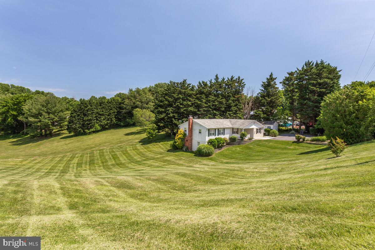 LOCATION, LOCATION, LOCATION – This peaceful bay breeze home is built on a beautiful 1.97-acre rolli