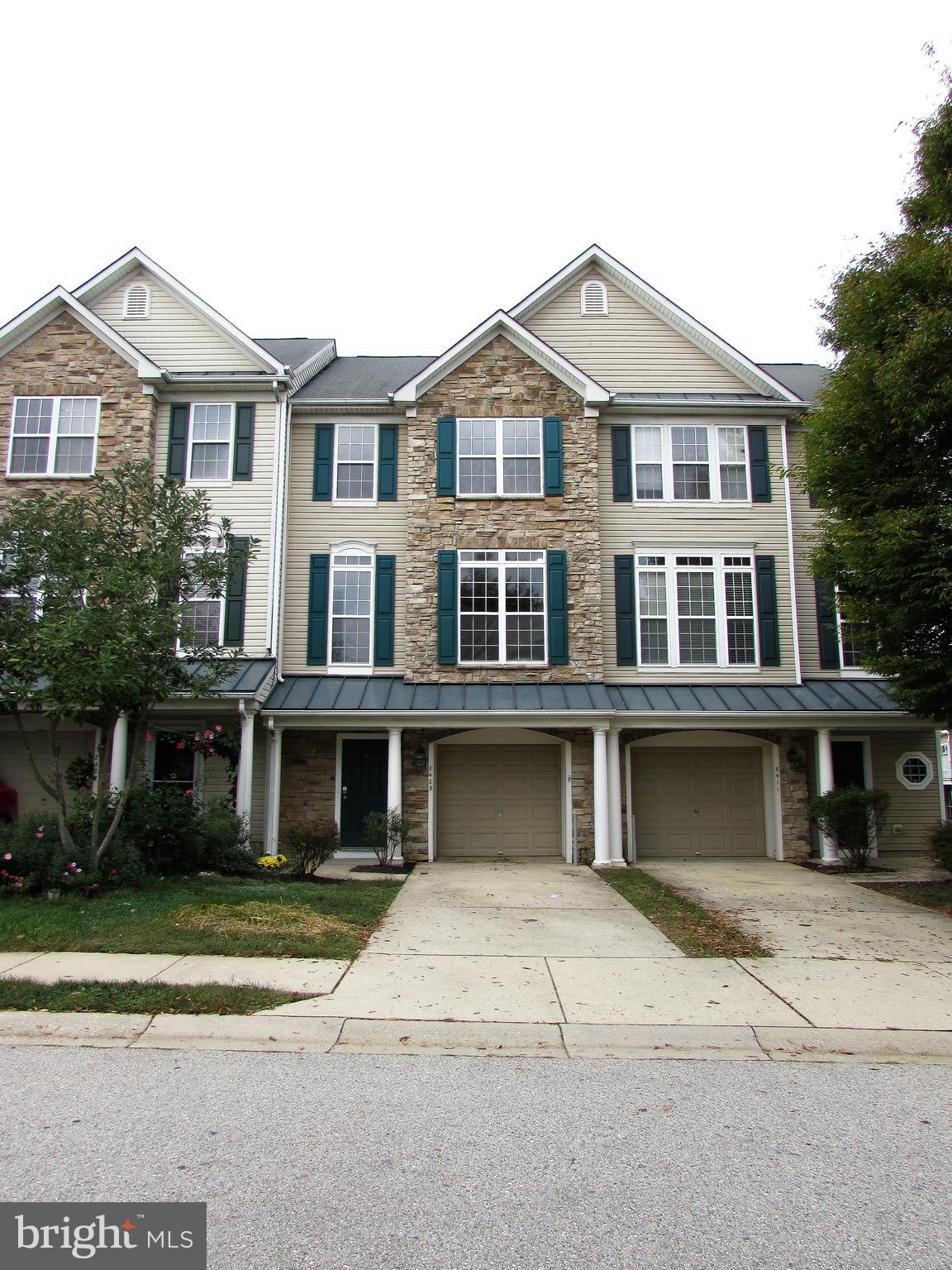 Just Remodeled - Columbia Builders 3-Level Garage Townhome in Sought After Emerson Community. 3BR's,