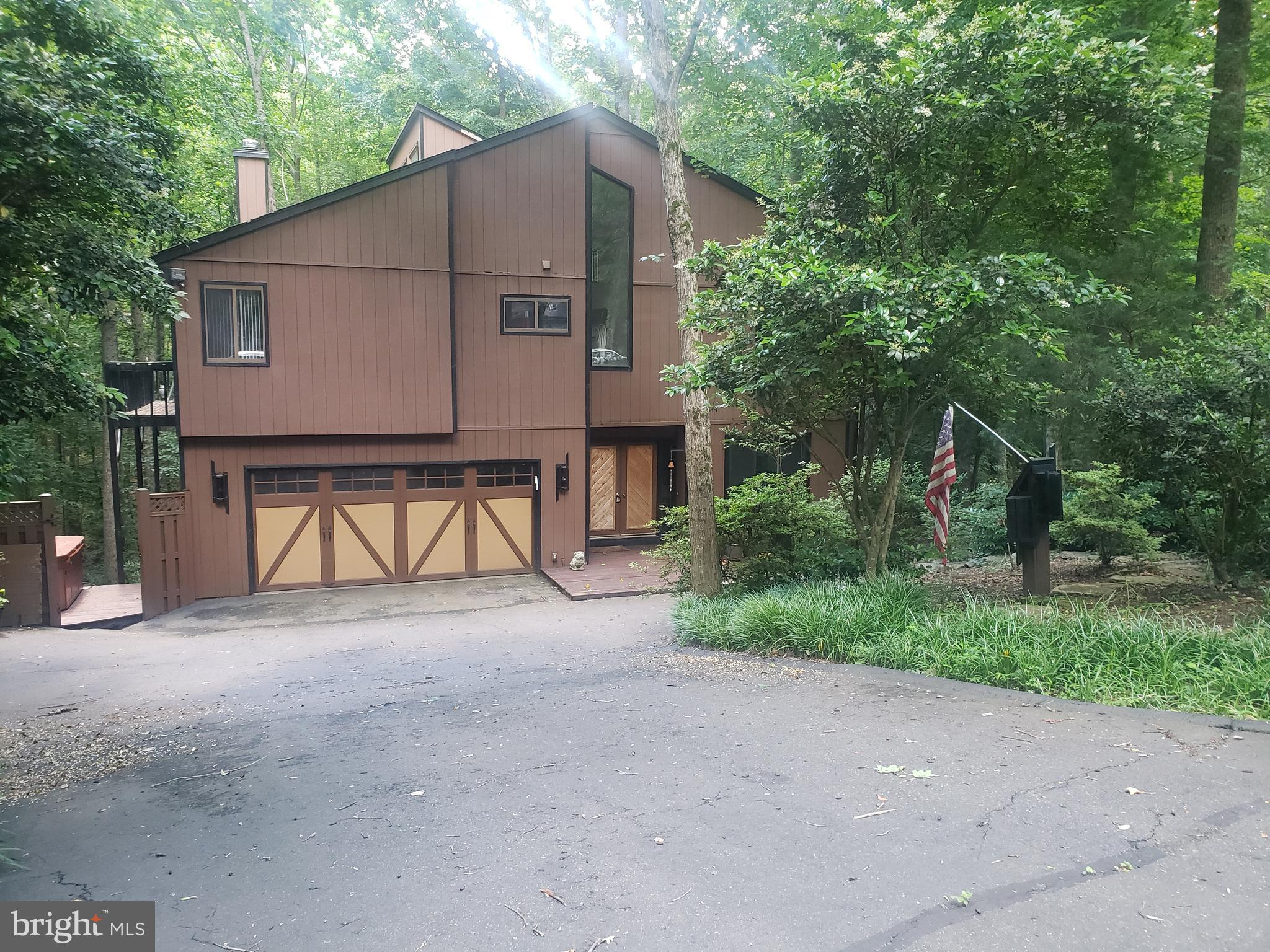Spacious 3 finished lvl home in popular Occoquan Forest ready for new owners! 3/4 BR 3 1/2 bath,  2 car garage, FP in LR, wood stove in 2 story great room & pellet stove in LL. Remodeled kitchen with cherry cabinetry, stainless appliances, bay window over sink &  corian counters with corian sink. Wood  & slate floors main lvl, wood on stairs. Multiple decks & scenic sunroom off great room with wooded views! Upper lvl loft off owners suite.