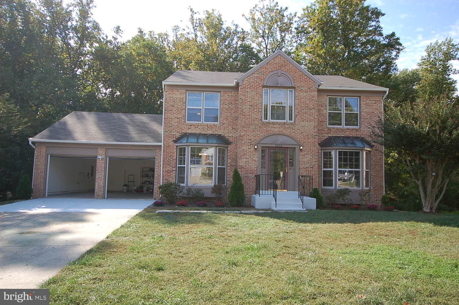 Stately brick front detached house features FIVE bedrooms, Three Full Bathrooms, One Half Bath and T