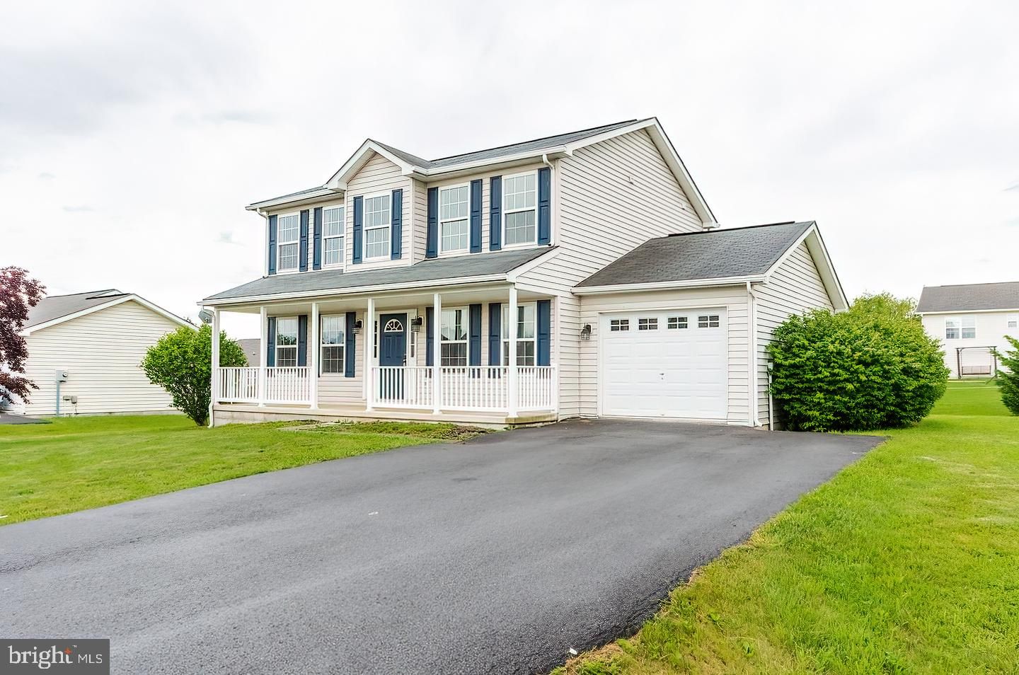 Beautifully maintained Colonial  with new paint and new flooring.  Main level features vaulted foyer
