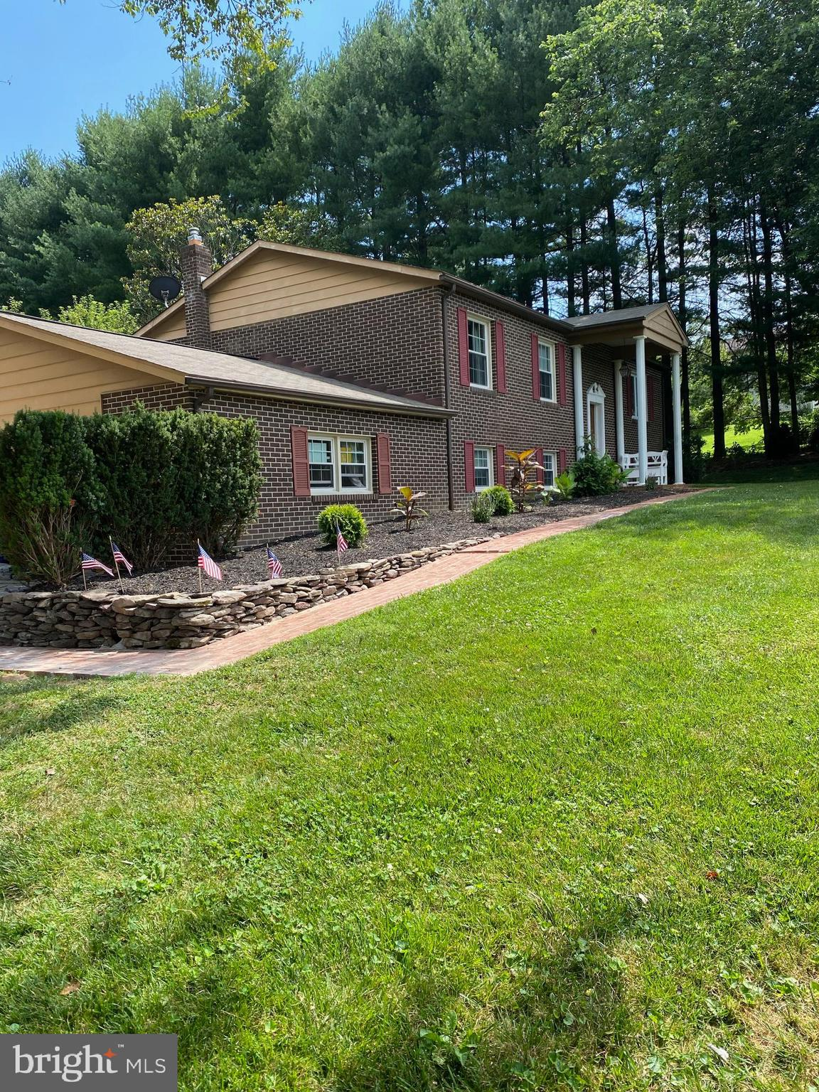 Welcome Home to this  country neighborhood, but close to Bel Air,  the property is on an acre of land with a fenced yard, great views  from the living room,   Crown molding and Chair rail  in the living room, dining room, and hallway.  Hardwood throughout  main level,   Some new  paint through out the house, Kitchen has trending blue gray color cabinet with white subway backsplash, new counter top, new floor  along with SS appliances.  The three bedrooms are on the main level,  Both master half bath and hall bath have been updated. Lower  level also has an updated full bathroom,  laundry room, (laundrychute from master bedroom to laundry room.   There is also a wood burning stove  for cold winters.  If you need a possible in-law suite/separate living,  this  property has the potential for it.  Also, has a whole house natural gas  generator, and plenty of storage, over sized two car garage with customized shelving, plenty of driveway parking,  room to put a personal garden ,  and two level patio for entertaining.