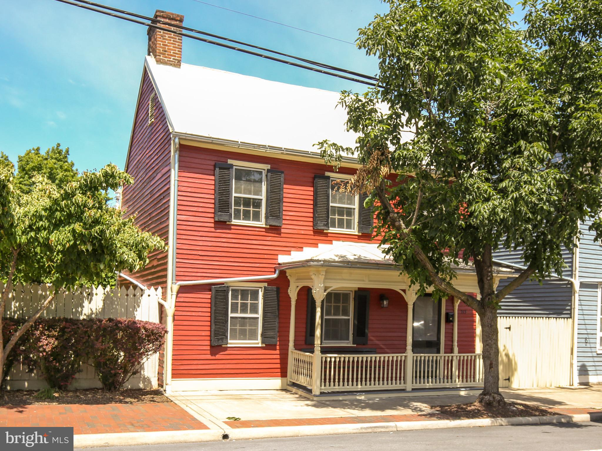 What a treasure in the heart of Winchester City! Built in 1759 and located within the Historic District, this renovated home is a rare find. Inside you will be greeted by meticulously restored plaster walls that you wish could talk and gleaming hardwood floors throughout. All new metal roof and gutters were installed in 2017. Home is listed as a four bedroom, but you do have to walk through one bedroom to access another, which is a typical layout of a house from this era. The spacious back yard has rear property access and covered off-street parking. Combined with non-metered parking out front, this house is made for gathering and enjoying all that is Old Town Winchester. Walk out the front door and you will discover the charm of a quaint community that offers restaurants, entertainment, shopping, museums, businesses, and more, within steps!   Home is zoned RB1. Whether for pleasure or business you will appreciate the ambiance and convenience this downtown location has to offer while being a part of the continued history of this unique property.