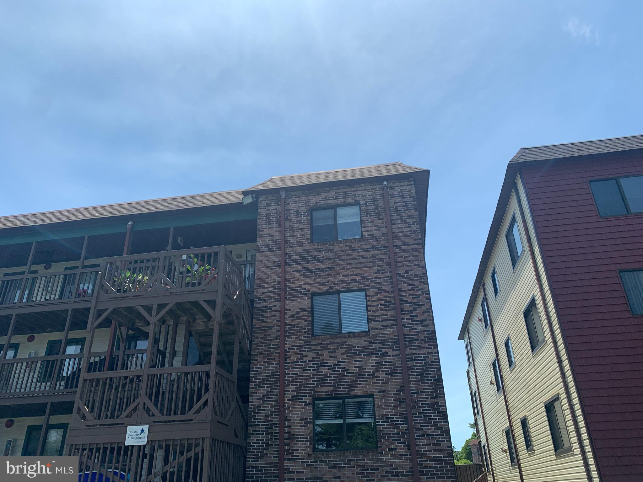 Come see this adorable and freshly painted and cleaned, 2 bedroom, 2 bath, end unit condo in Caine Woods with a community pool!  Check out all the natural light in this uptown condo.  Unit features newer HVAC (2017), porcelain flooring throughout (2014), new toilets  and vanities (2016),  washer and dryer (2019), stainless steal refrigerator (2016),  stainless steel dishwasher (2019),  and replacement doors in hall, closets and bedrooms.  Master bedroom deck overlooks the pool.  Balcony slider recently replaced.   Walk to many local restaurants.  Bring your bathing suits and beach gear and enjoy the end of summer and OC's second season!!!