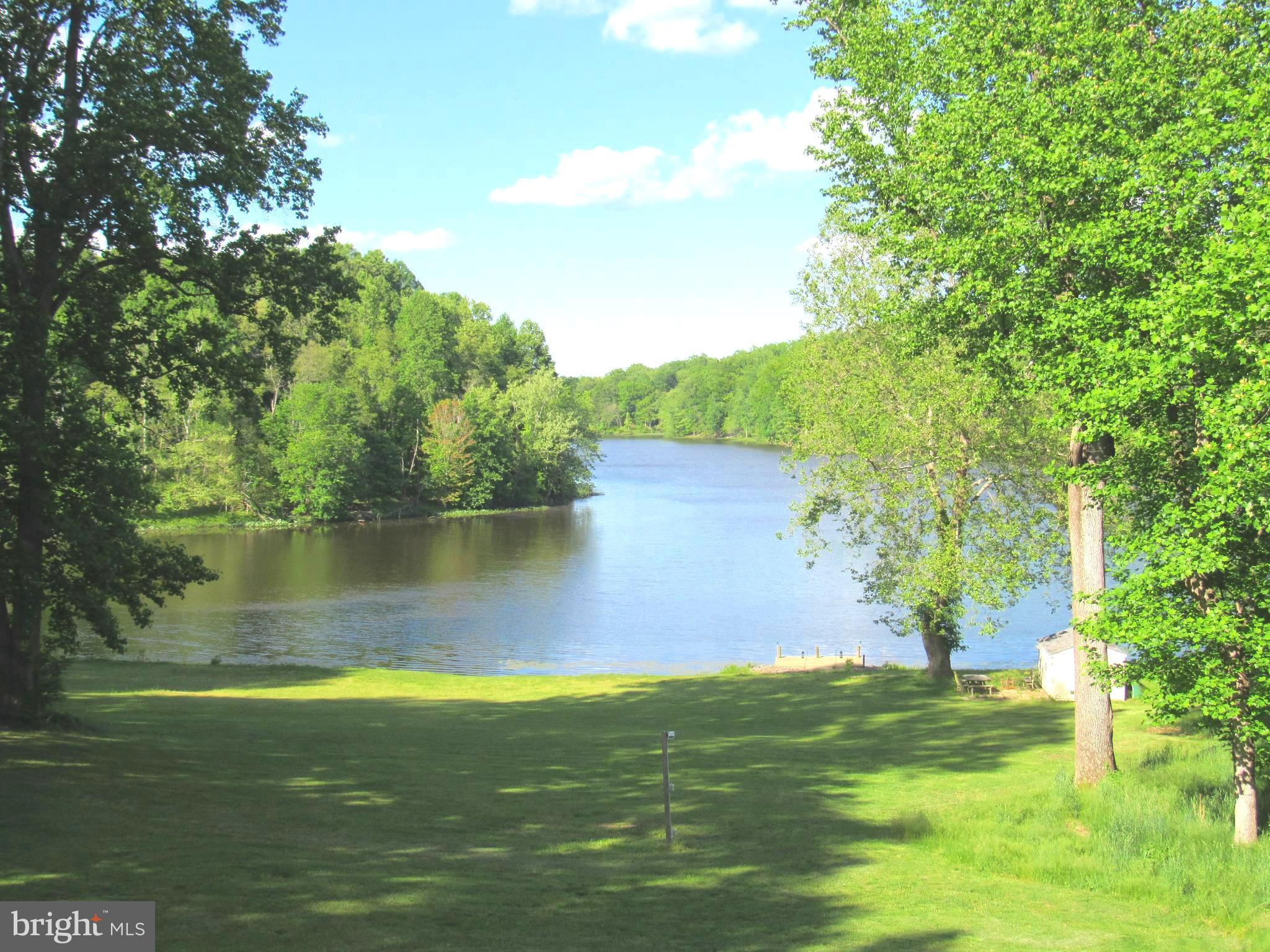 Million Dollar Views !! Come home to this  stunning waterfront property on sought after Lake Jameson where you can escape to your own enchanted place.  Property features gorgeous lawn  with shoreline to the  lake  and a private pier with direct water access  for swimming, fishing, boating  or relaxing.  You can also relax at your own swimming pool or on the screened porch, patio or one of several decks which all  have gorgeous views of the lake.  There is a storage shed at the lake to store all your water toys and equipment. House has room for everyone  5400 +  finished square feet with 6 bedrooms and 5 1/2 bathrooms. The main house has 5 bedrooms  and 4 1/2 bathrooms .  There is also a living room, separate dining room family room with propane fireplace.  Gorgeous staircase to  upper level has large master bedroom with newly renovated master bathroom  with a huge  luxury shower, double vanities and beautiful ceramic tile. There are 3 additional  bedrooms and a  bathroom also upper level laundry room.  Walk out lower level features family room/office,  bedroom,  2 full  bathrooms with access out the back to the pool and lake. Stunning views  of the lake from almost every room including the lower level. Home also has an in-law apartment   with a separate entrance  featuring living room with gas fireplace , eating area, full kitchen , bedroom and full bathroom.  Apartment  also has  washer and dryer . This could be a great rental for additional income to off set the mortgage payment.  It could easily be made into a two bedroom apartment. There is a 2 car attached garage and detached 3 car garage  total of 1260+ sq ft of garage space and paved driveway for plenty of additional parking. The solar panel lease conveys with the property.