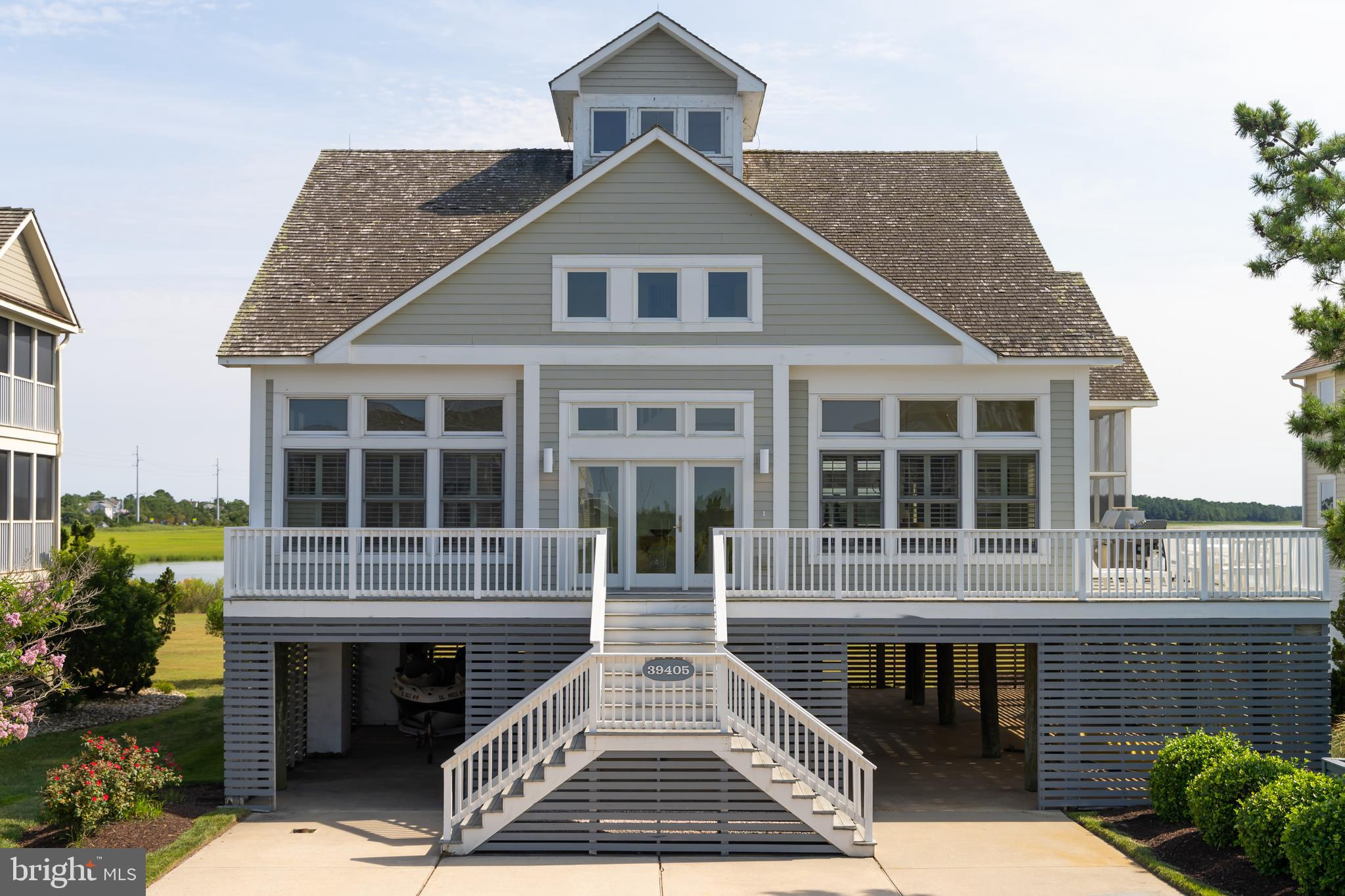 Coastal-style living at its best! This custom-built waterfront home is nestled in the sought-after w