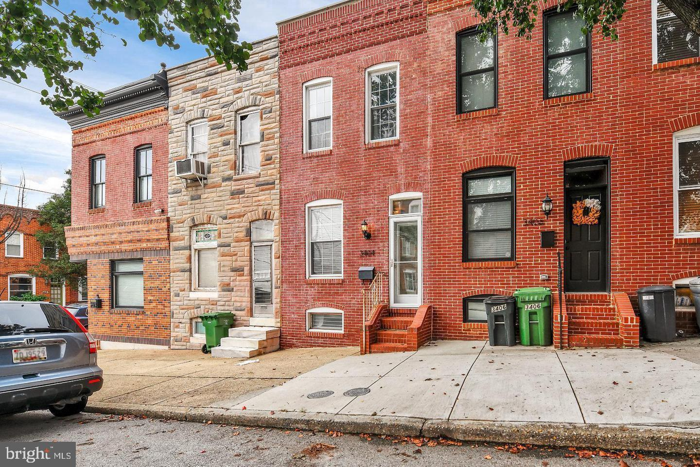 Charming 2 BR 2 BA Row home located in prime Canton Location.  Walking distance to Canton Square, Canton Crossing, and Brewers Hill! Updated kitchen (2012), upper bathroom (2017), roof and HWH (2018), with original hardwood floors and exposed brick throughout main level. Large walk-in closet with shelving conveys.  Finished lower level and parking pad.