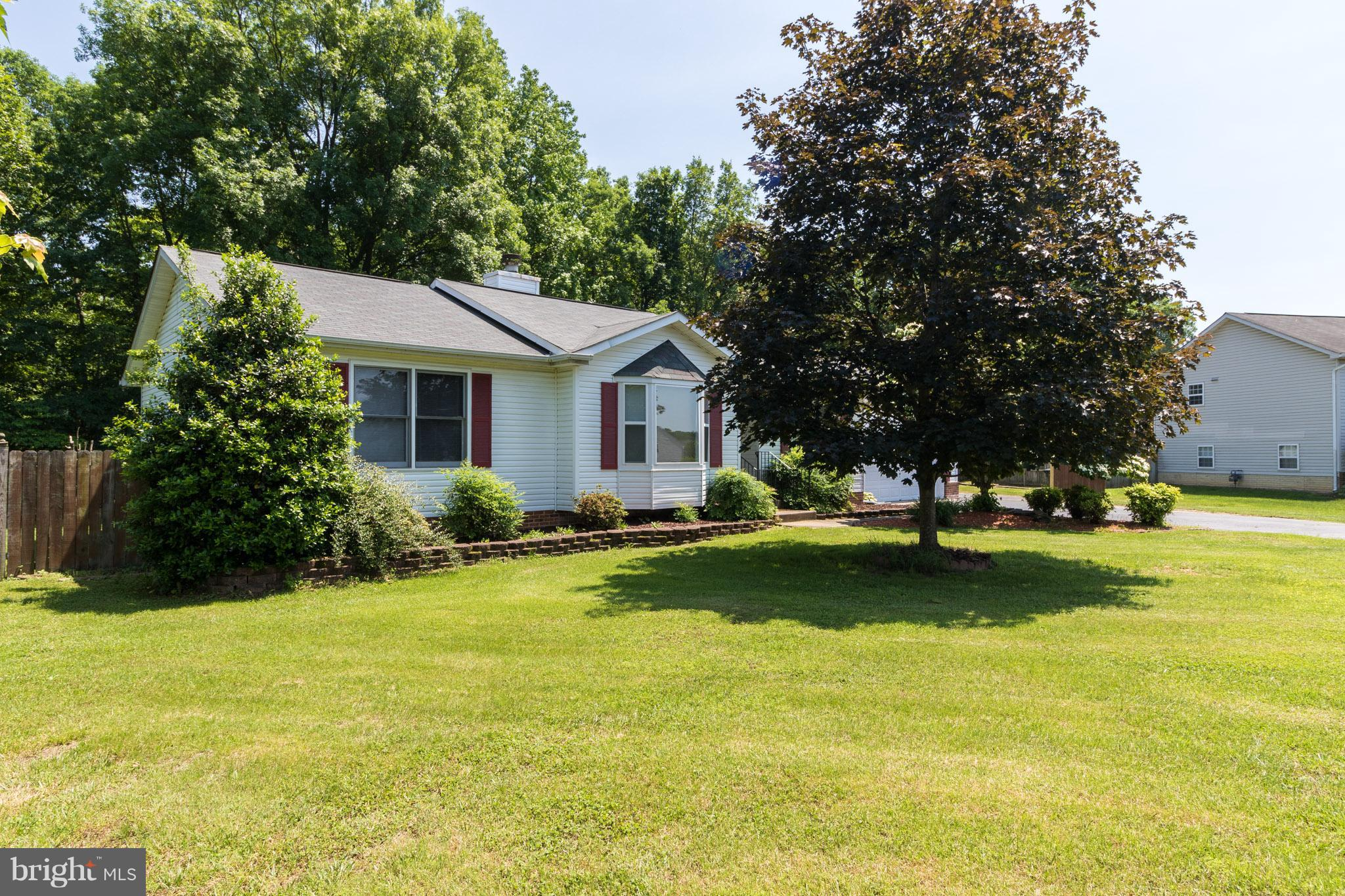 Spacious Rambler on a Cul-de-sac lot. Over 3100 SF of Finished Space. Price Per SF is $104. Sun-room overlooks Fenced Backyard and wooded bird sanctuary - wild-life galore! 4 BRs (1 NTC) 3 Full Baths (1 Handicap Accessible.) Full,  Finished Basement includes huge Utility/Workshop with shelving. Solid wood doors and stained trim throughout first floor. 2 Car Attached Garage includes Handicap Chair Lift. NO HOA!