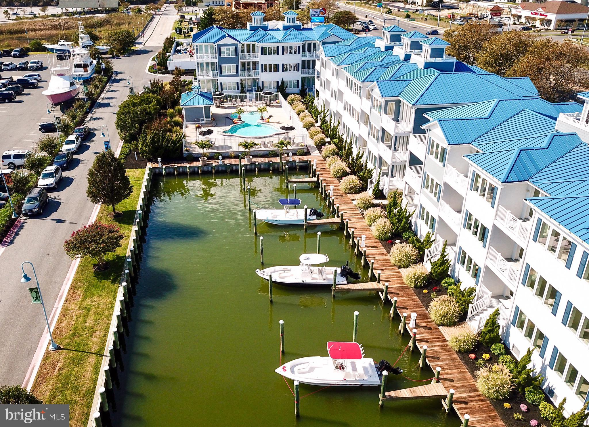 """When nothing but the best will do - The Villas at Inlet Isle is the place for you.  PRIME WEST OCEAN CITY LOCATION!!! Only a few units left.   Luxury 3,069  sq. ft. solid concrete block constructed  townhomes with soundproof windows and doors,   3 spacious bedrooms and 4 full baths,  large boat slip, private elevator, two car garage, soaring 9 ft. ceilings with tall windows throughout, outdoor living area on every level, large master ensuite with sitting area, his and hers large walk-in closets, spa like  master bath.   Southern exposed heated community pool w/bathhouse & outdoor shower, and much more. This unit is ready for immediate delivery.  List price does not include furnishings. Furnishings can be purchased from BRF at closing.  The units at The Villas at Inlet Isle are an absolute must see.    More details about the project can be found on  fb at  """"The Villas at Inlet Isle, Ocean City,  MD""""  (PLEASE BEWARE -  websites you may find online offering information about the Villas at Inlet Isle are not authentic to the project and do not provide accurate or current information.)"""
