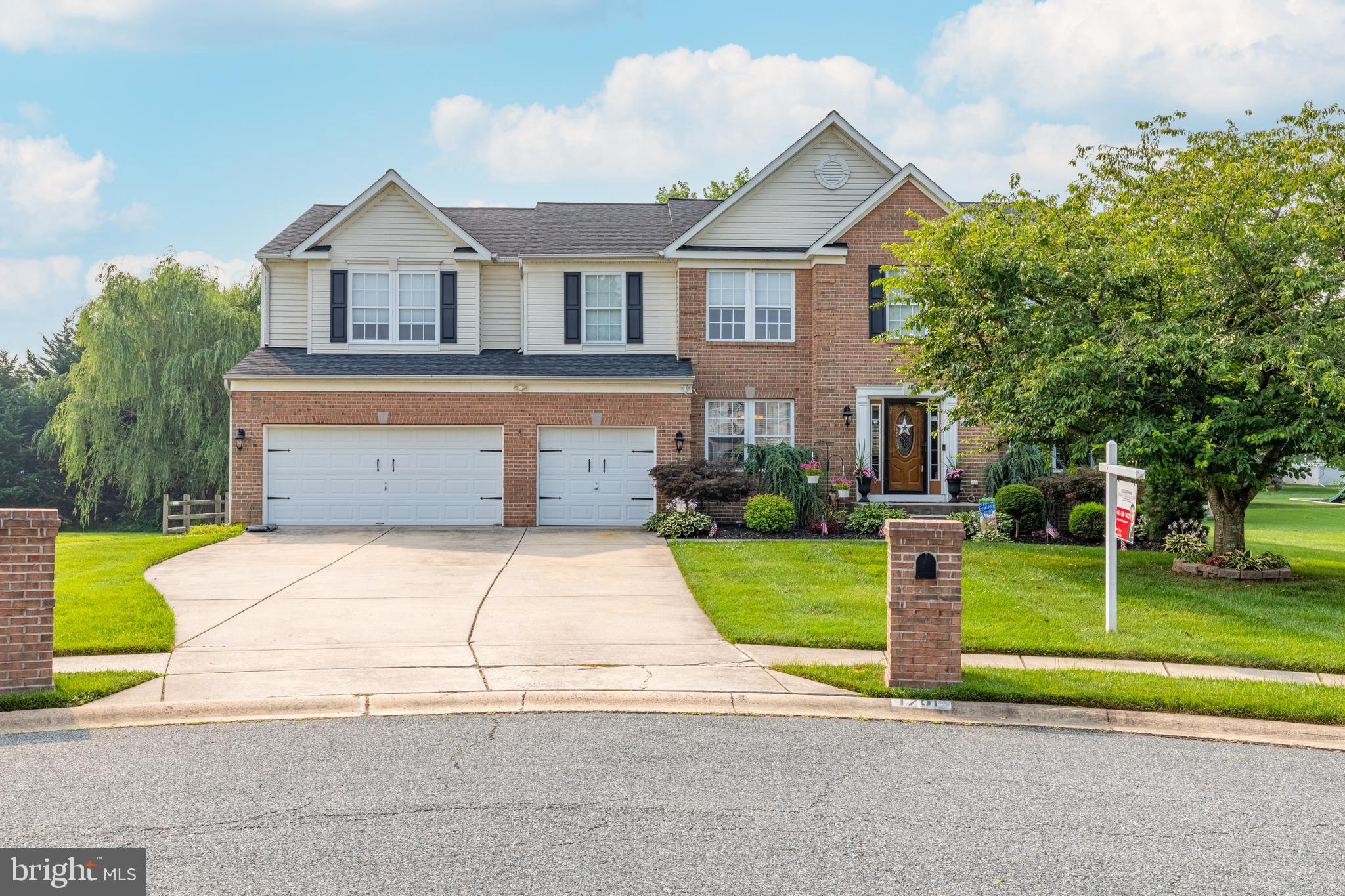 Rare opportunity to own this impressive brick-front colonial with three car garage in sought after W